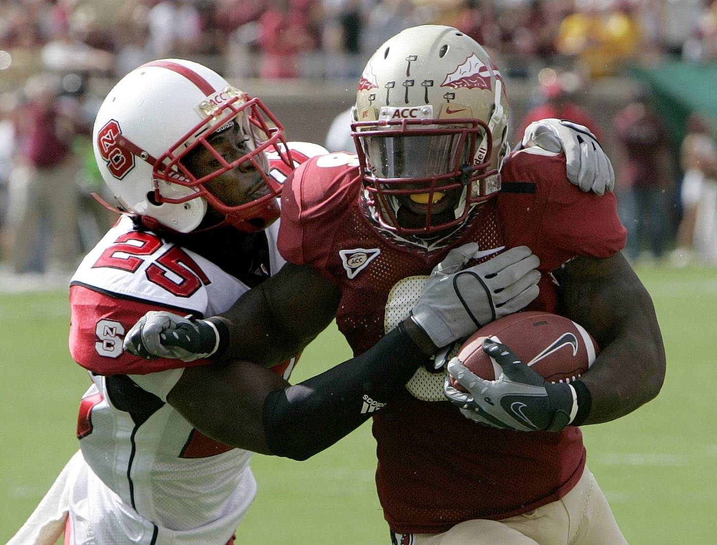 Florida State running back Antone Smith, right, runs during the first quarter as North Carolina State's Miguel Scott attempts to make the tackle. (AP Photo/Phil Coale)