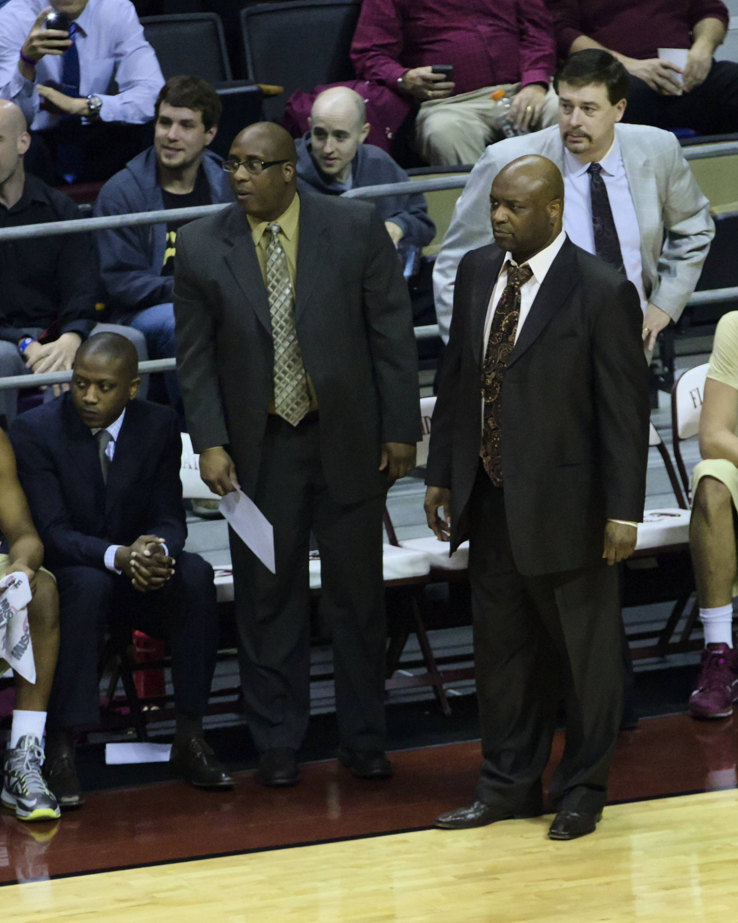 FSU Coaching Staff, Assistant Coaches Dennis Gates, Corey Williams, Head Coach Leonard Hamilton, Associate Head Coach Stan Jones, FSU vs Virginia, 03/07/13. (Photo by Steve Musco)