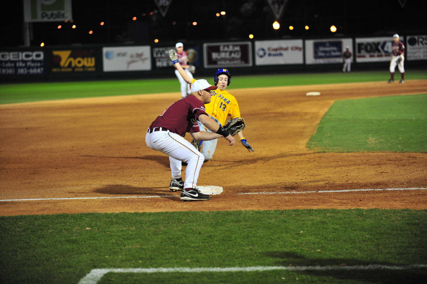 Stuart Tapley receives a throw from Rafael Lopez and tags out Hofstra's Mark Stuckless trying to steal third in the top of the ninth.