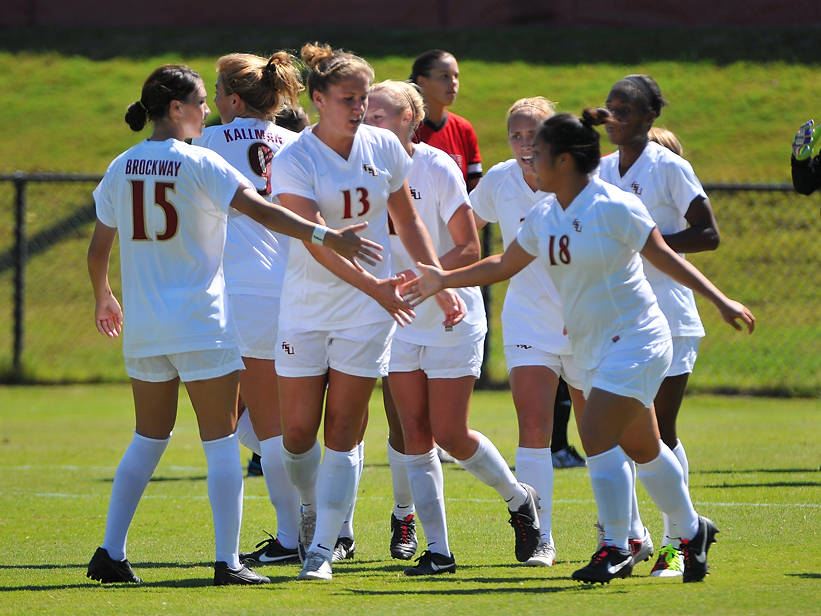 The Seminoles celebrate after scoring their first goal of the season.