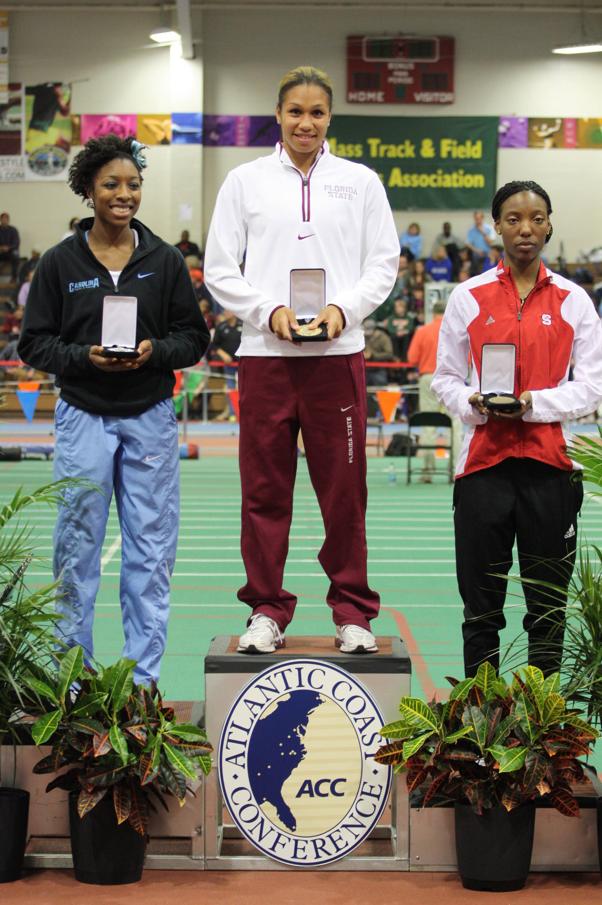 Senior Amy Harris climbed atop the podium after winning the long jump ....