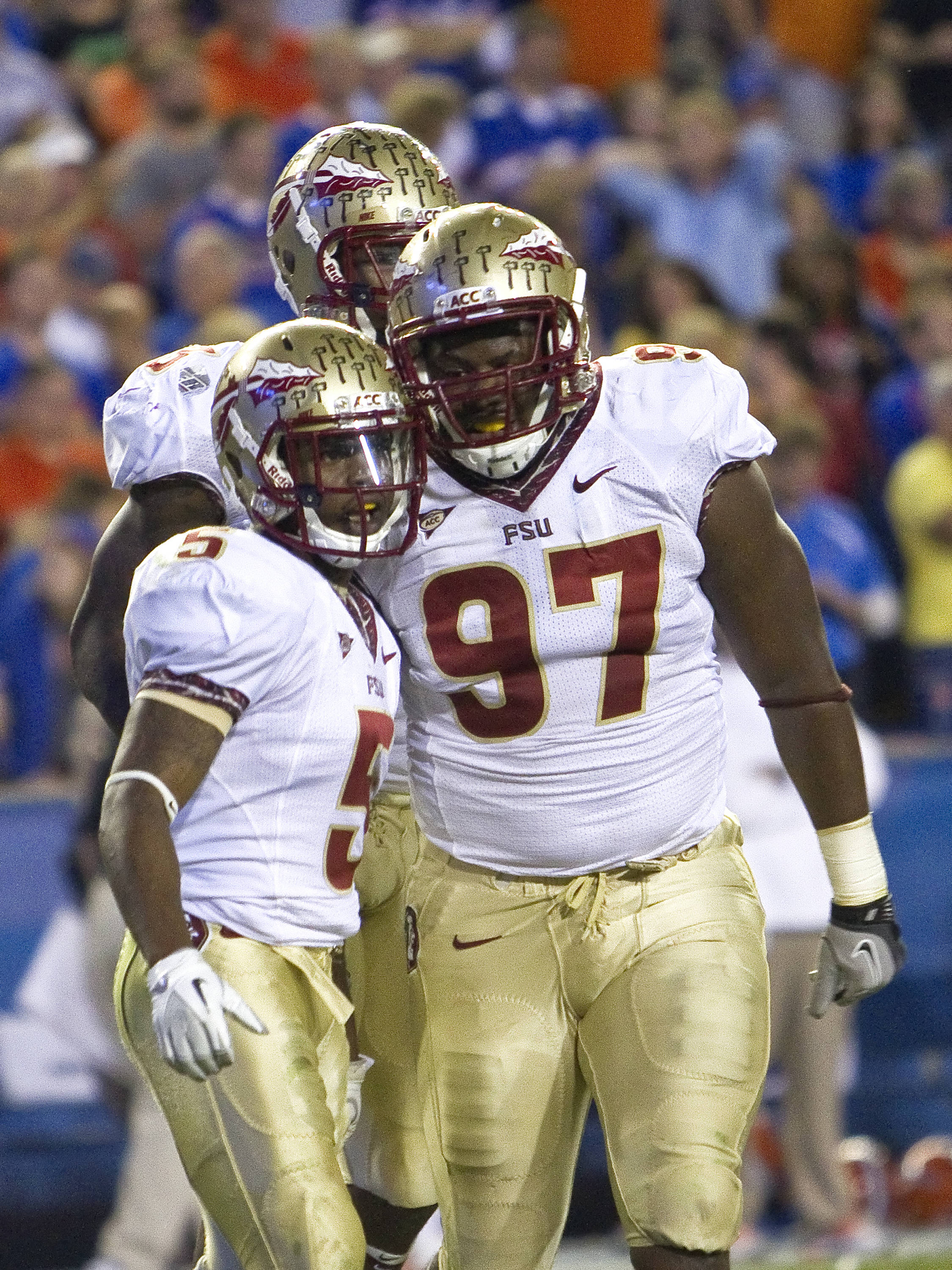 Demonte McAllister (97) and Greg Reid (5) celebrate a defensive stop, FSU vs Florida, 11/26/2011