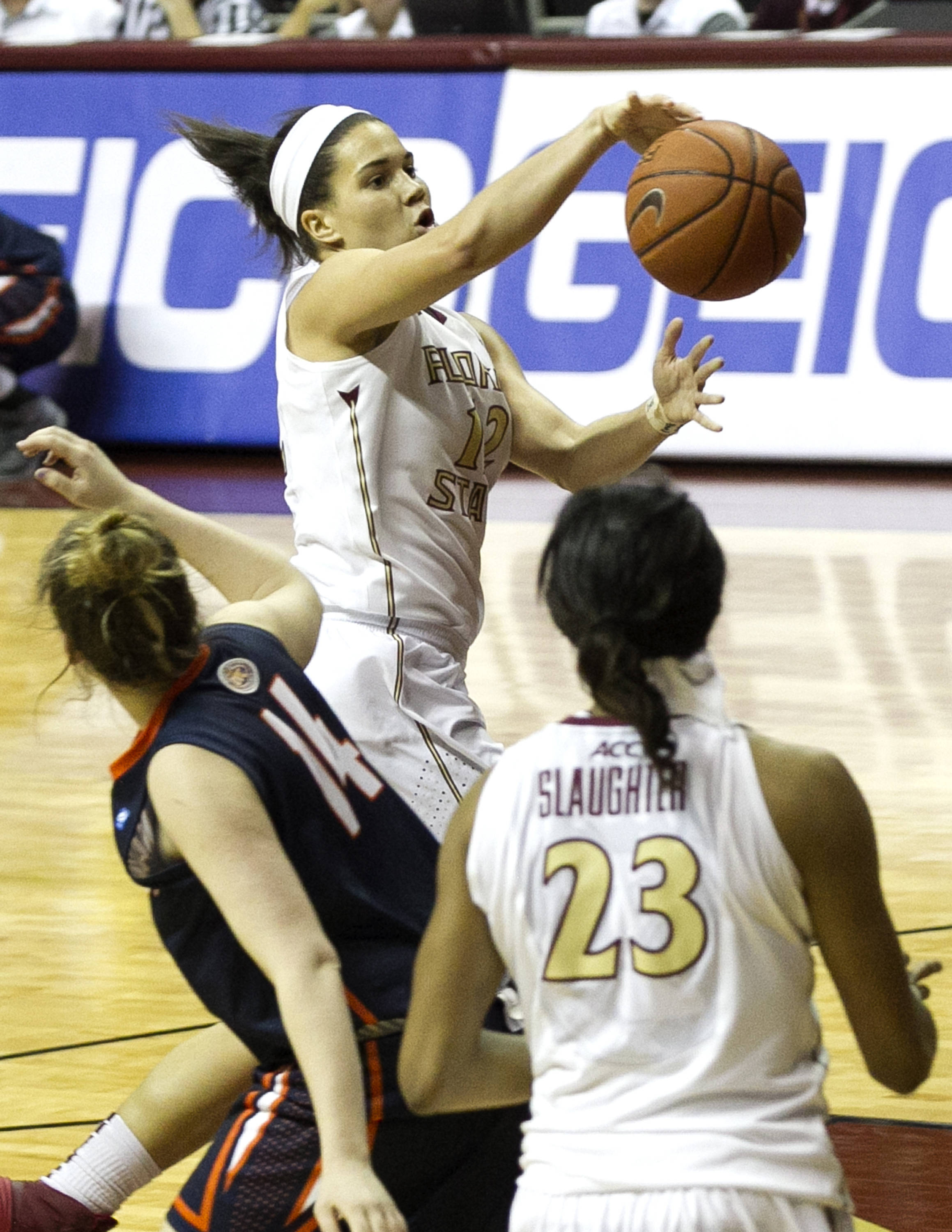 Brittany Brown (12) with a pass in the paint leading to an assist to Ivey Slaughter (23), FSU vs UT Martin, 12-28-13,  (Photo by Steve Musco)