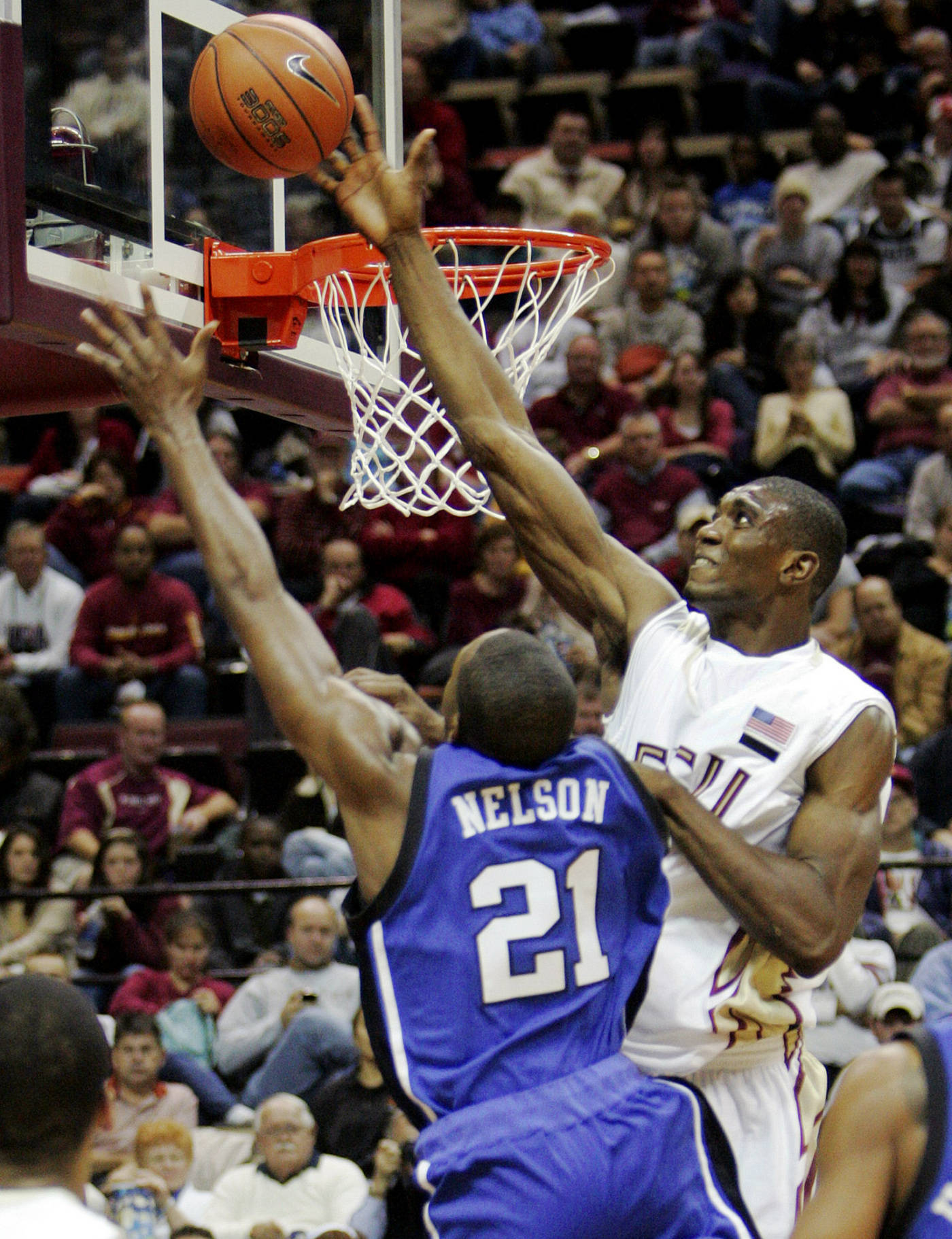 Florida State's Uche Echefu blocks the shot of Duke's DeMarcus Nelson in the second half of a college basketball game which Duke won 70-57 on Wednesday, Jan. 16, 2008 in Tallahassee, Fla.