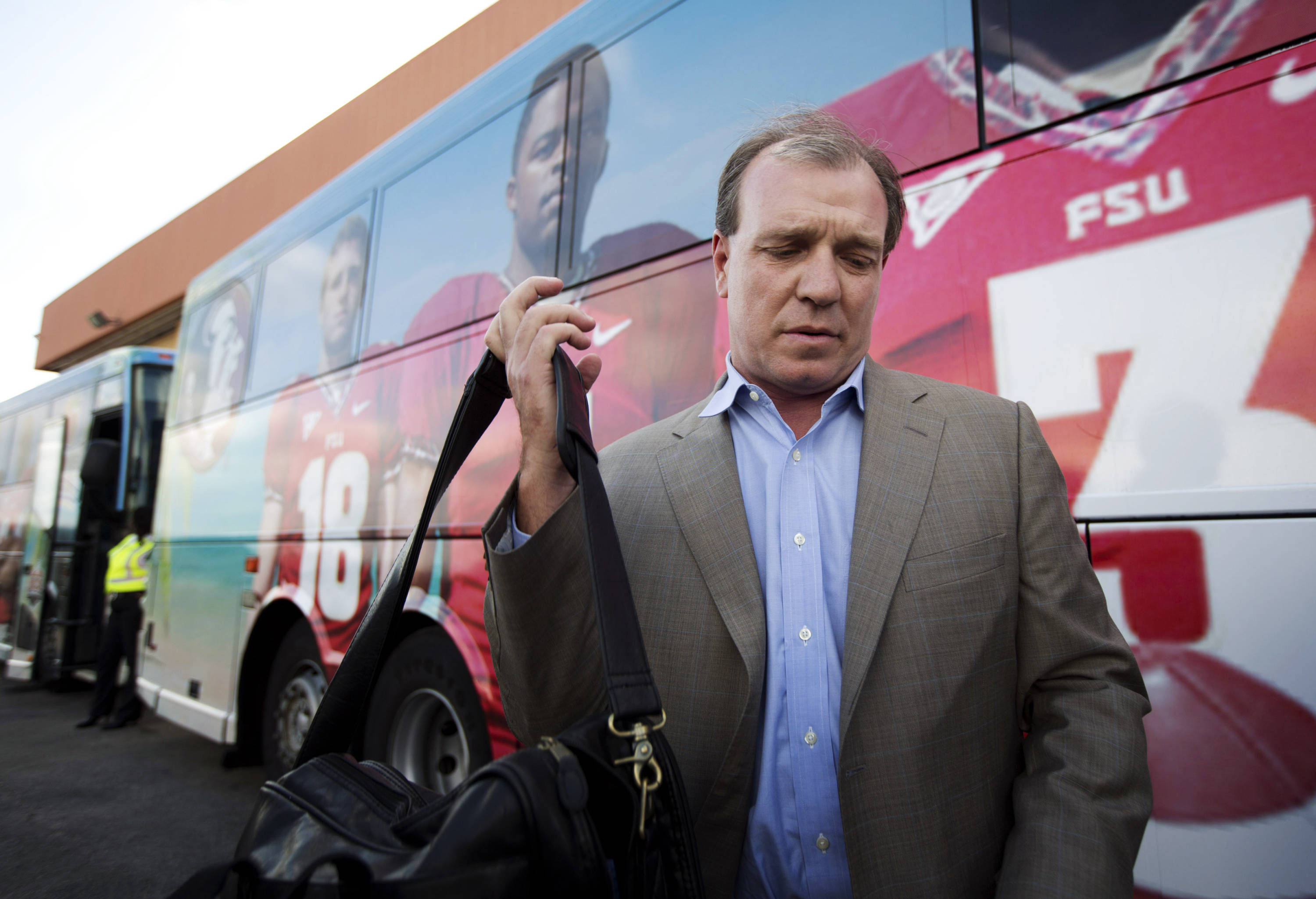 Florida State head coach Jimbo Fisher prepares to load onto a team bus, Wednesday, Dec. 26, 2012, after his team arrived in Fort Lauderdale, Fla. Florida State is scheduled to play Northern Illinois in the in the Orange Bowl NCAA college football game on Tuesday, Jan. 1, 2013, in Miami. (AP Photo/J Pat Carter)
