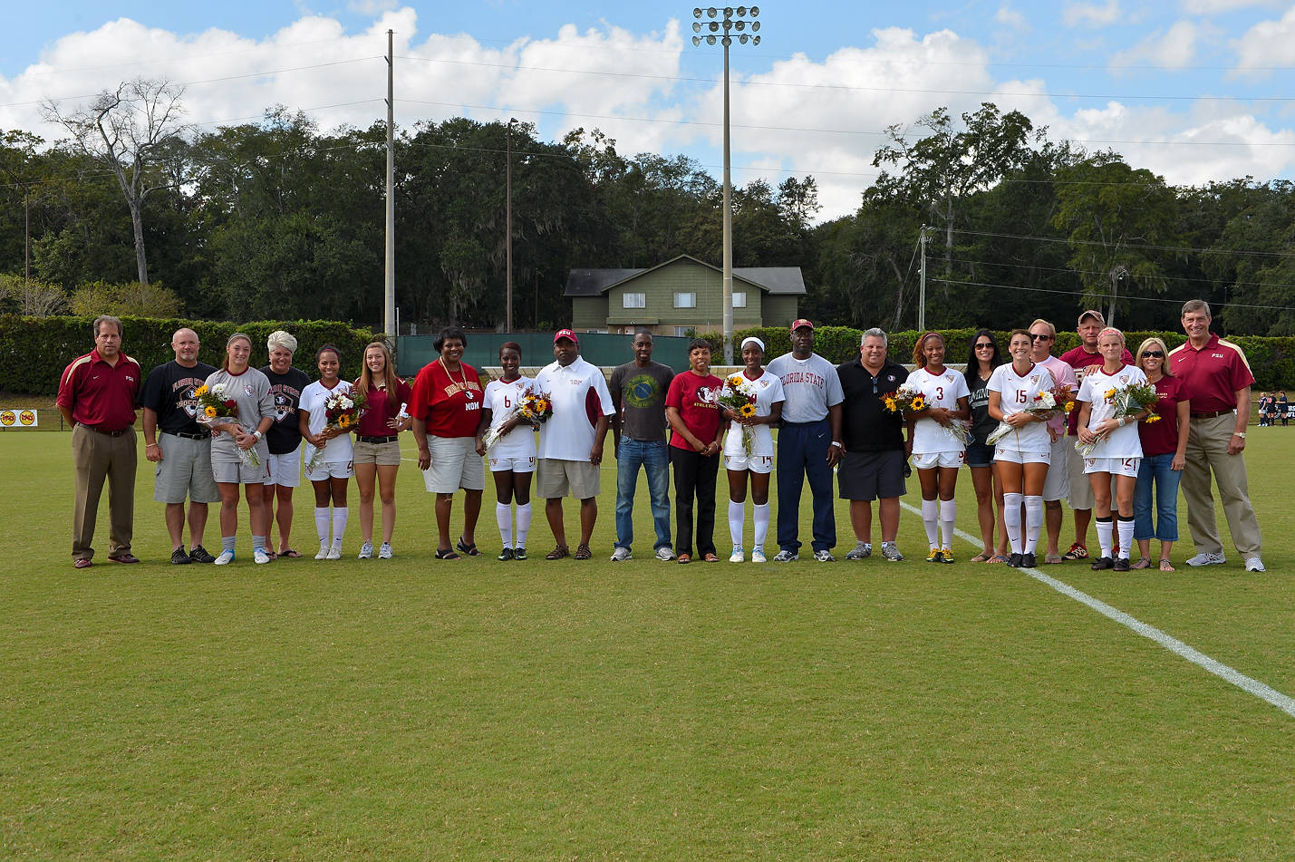 The 2012 Seminole Senior Class, their families, head coach Mark Krikorian and FSU Athletics Director Randy Spetman.