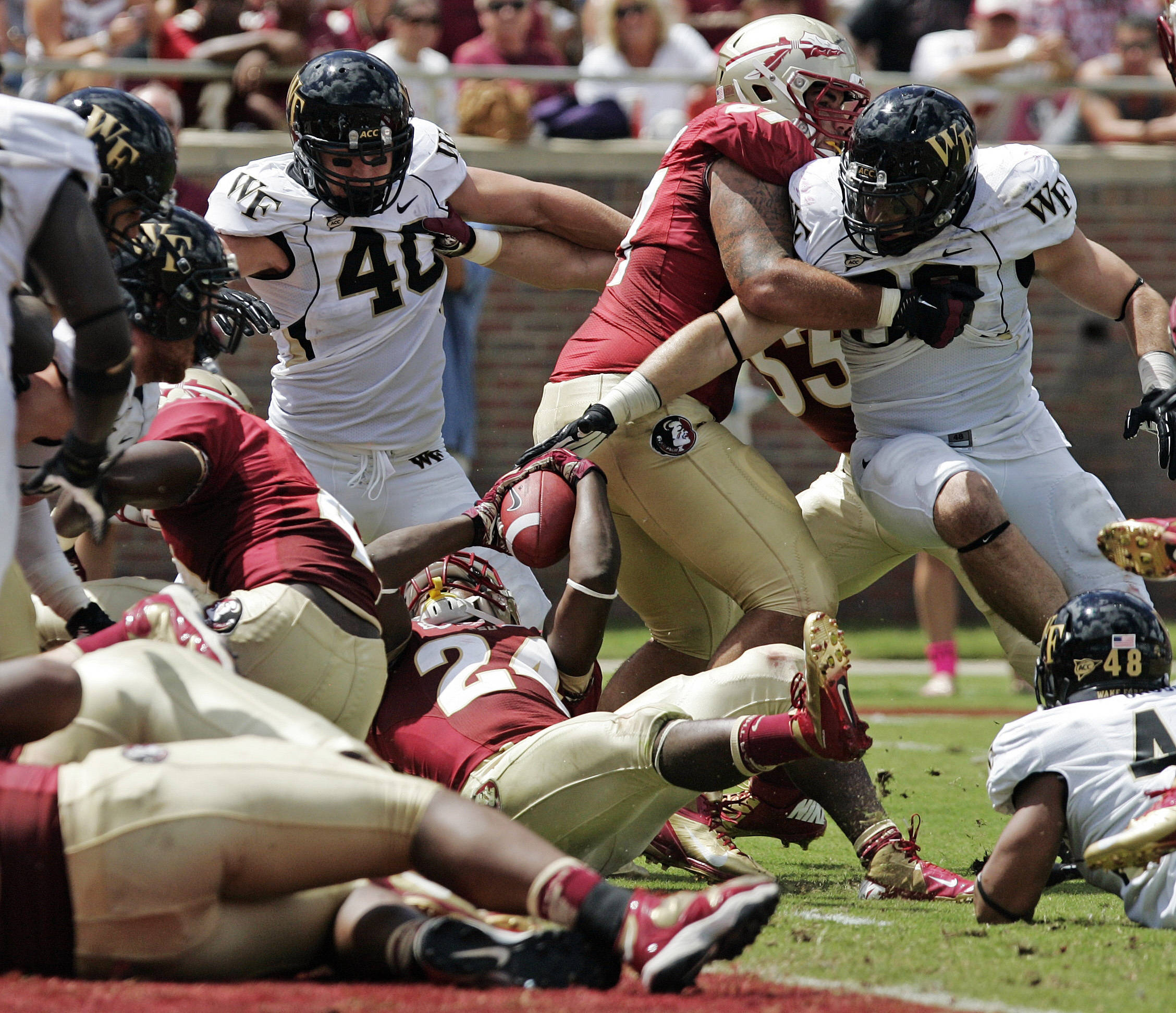 The Wake Forest defense stops Florida State's Lonnie Pryor from scoring. Florida State won 52-0. (AP Photo/Steve Cannon)