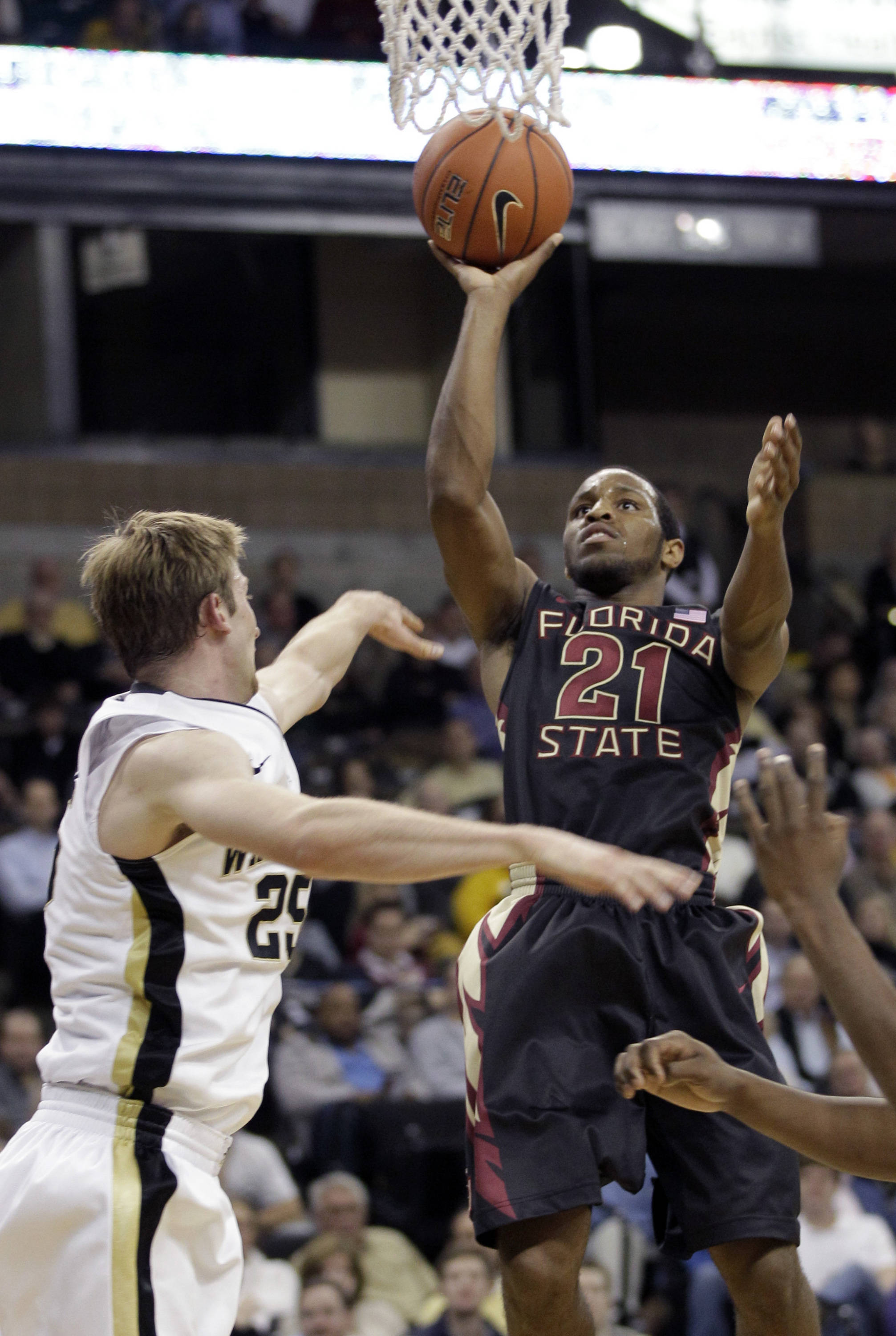 Florida State's Michael Snaer shoots over Wake Forest's Nikita Mescheriakov. (AP Photo/Chuck Burton)