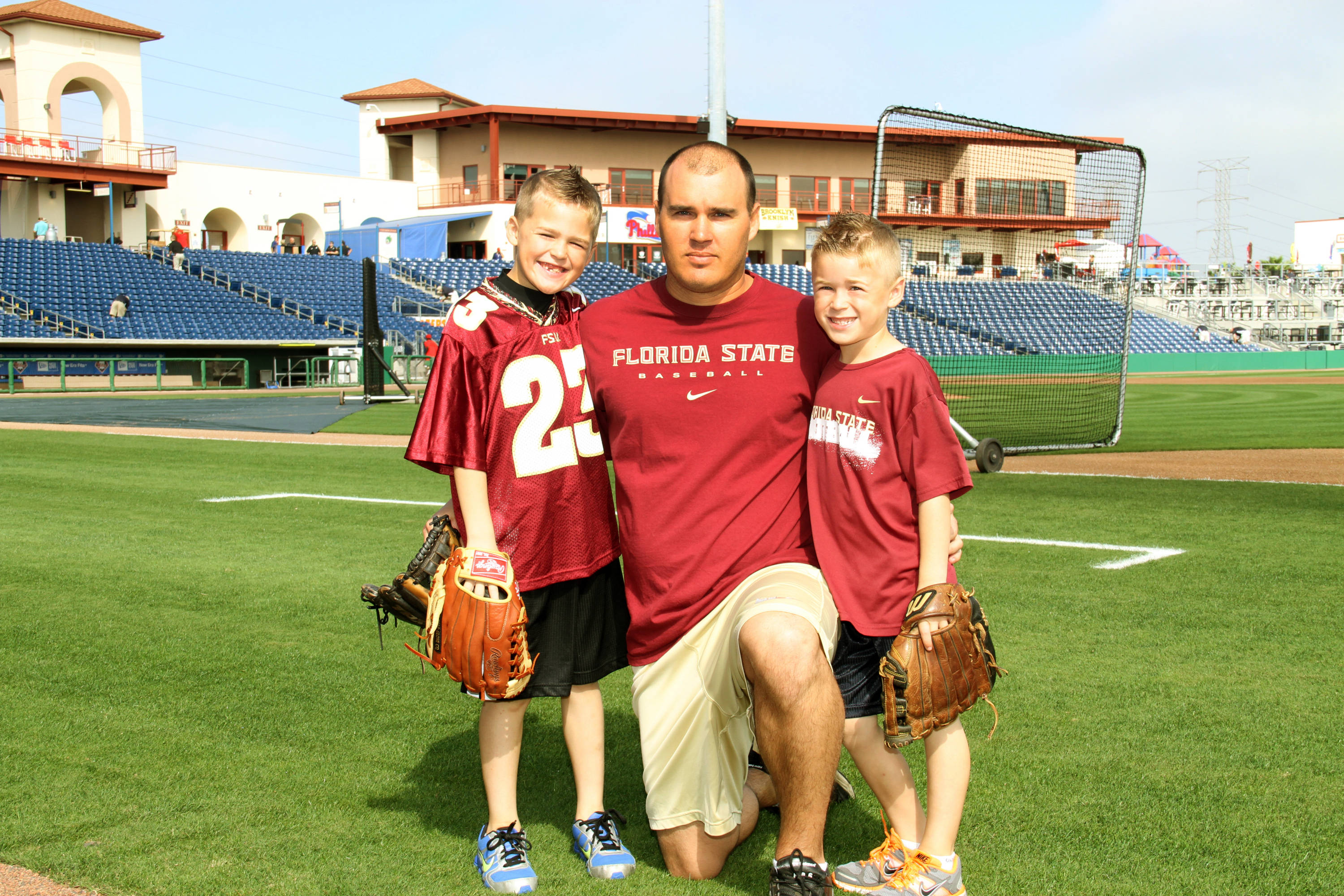 Former Seminole All-American Marshall McDougall and his kids at the Phillies game in Clearwater.