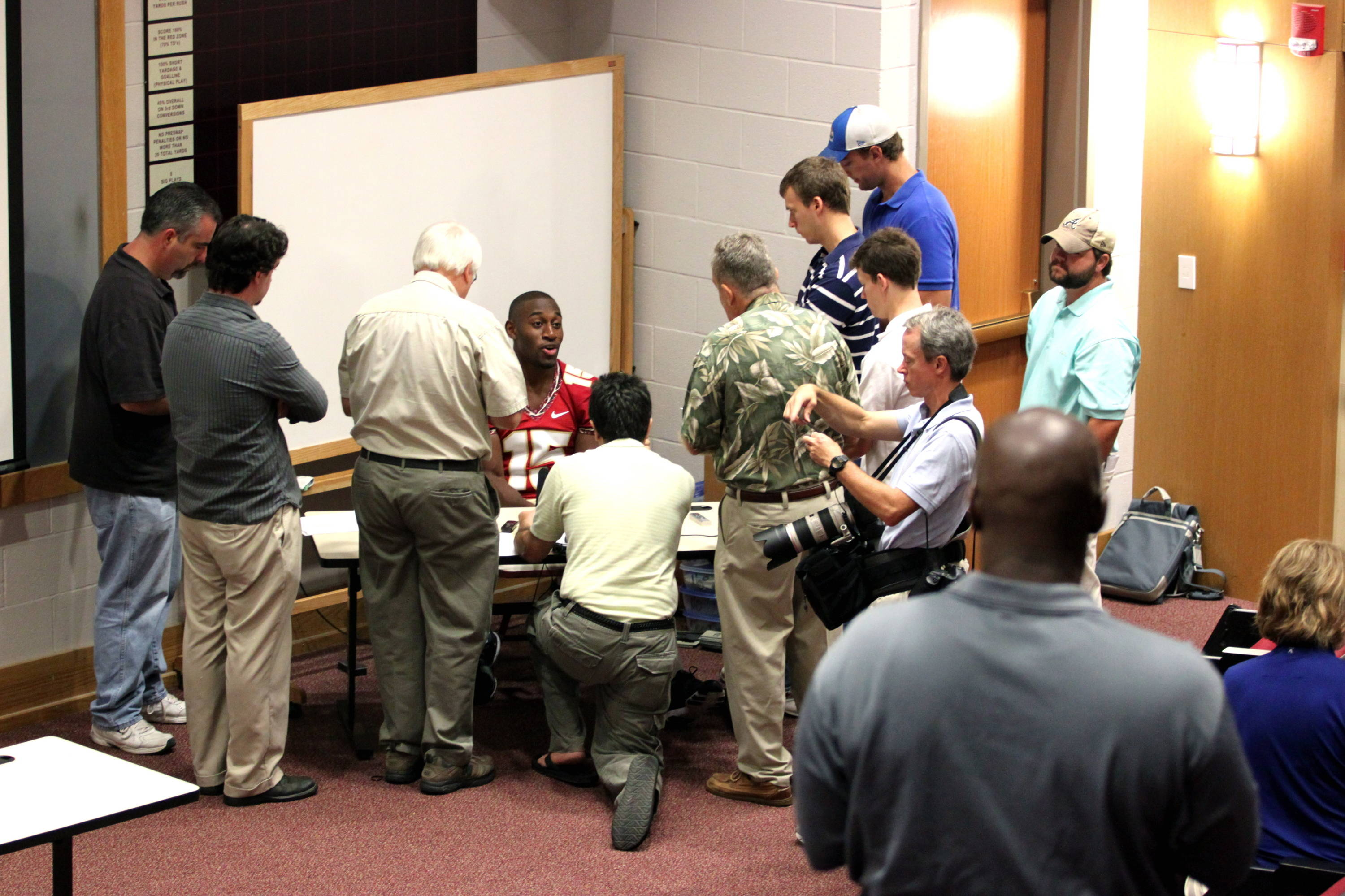 Ochuko Jenije (15) meeting with the print media at football media day.