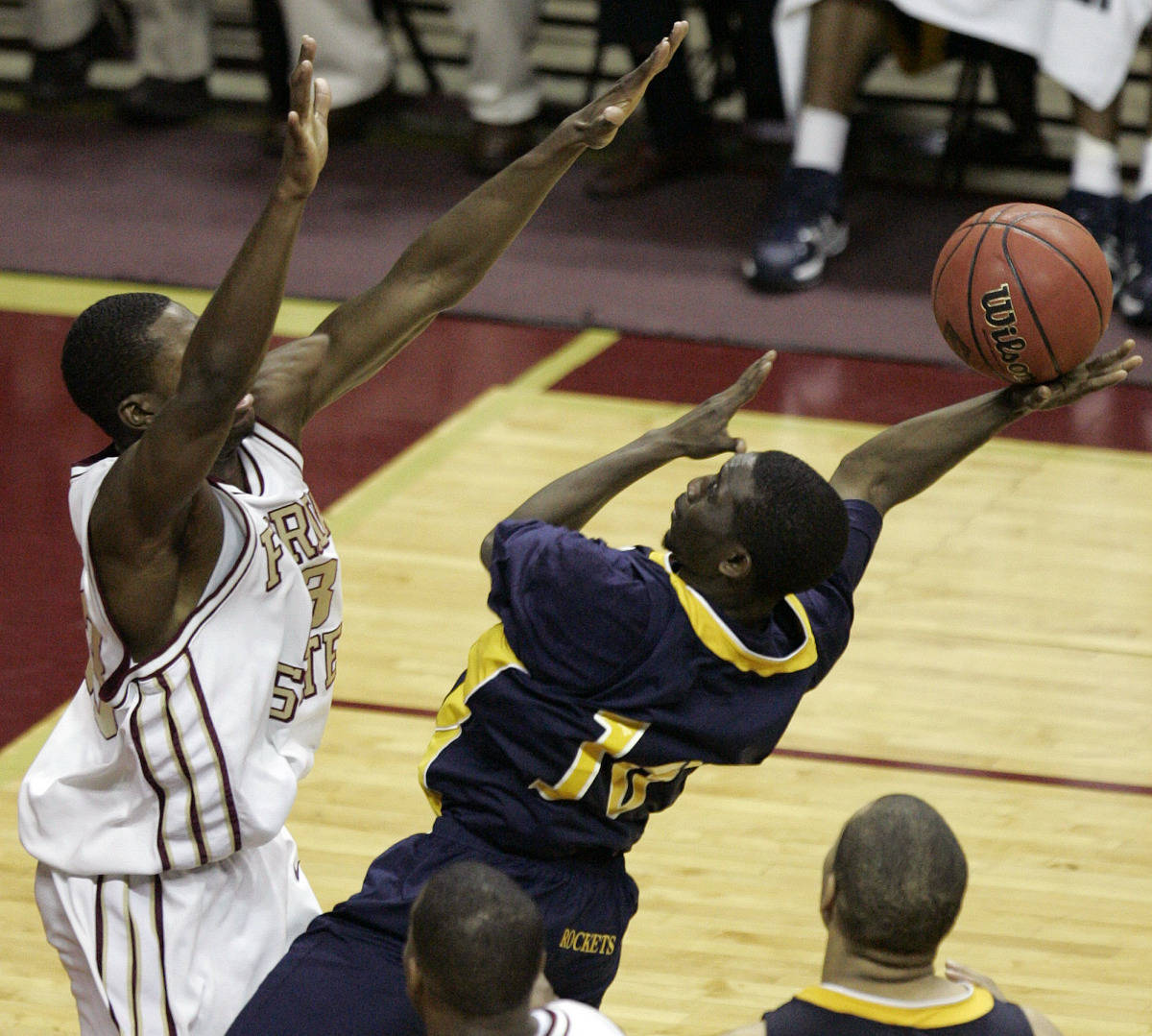 Toledo's Kashif Payne couldn't get this off-balance shot to fall as Florida State's Isaiah Swann provides the defense. (AP Photo/Steve Cannon)