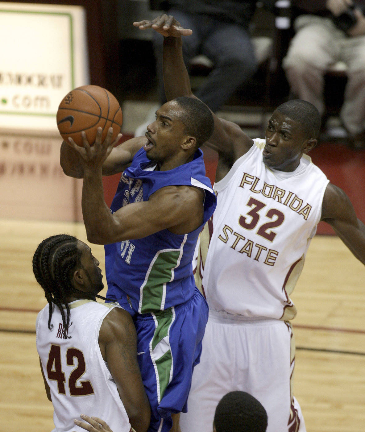 Texas A&M-Corpus Christi's Demond Watt, center, tries for a first-half layup between Florida State's Ryan Reid, left, and Solomon Alabi, right, during an NCAA college basketball game Monday, Jan. 4, 2010, in Tallahassee, Fla. (AP Photo/Phil Coale)