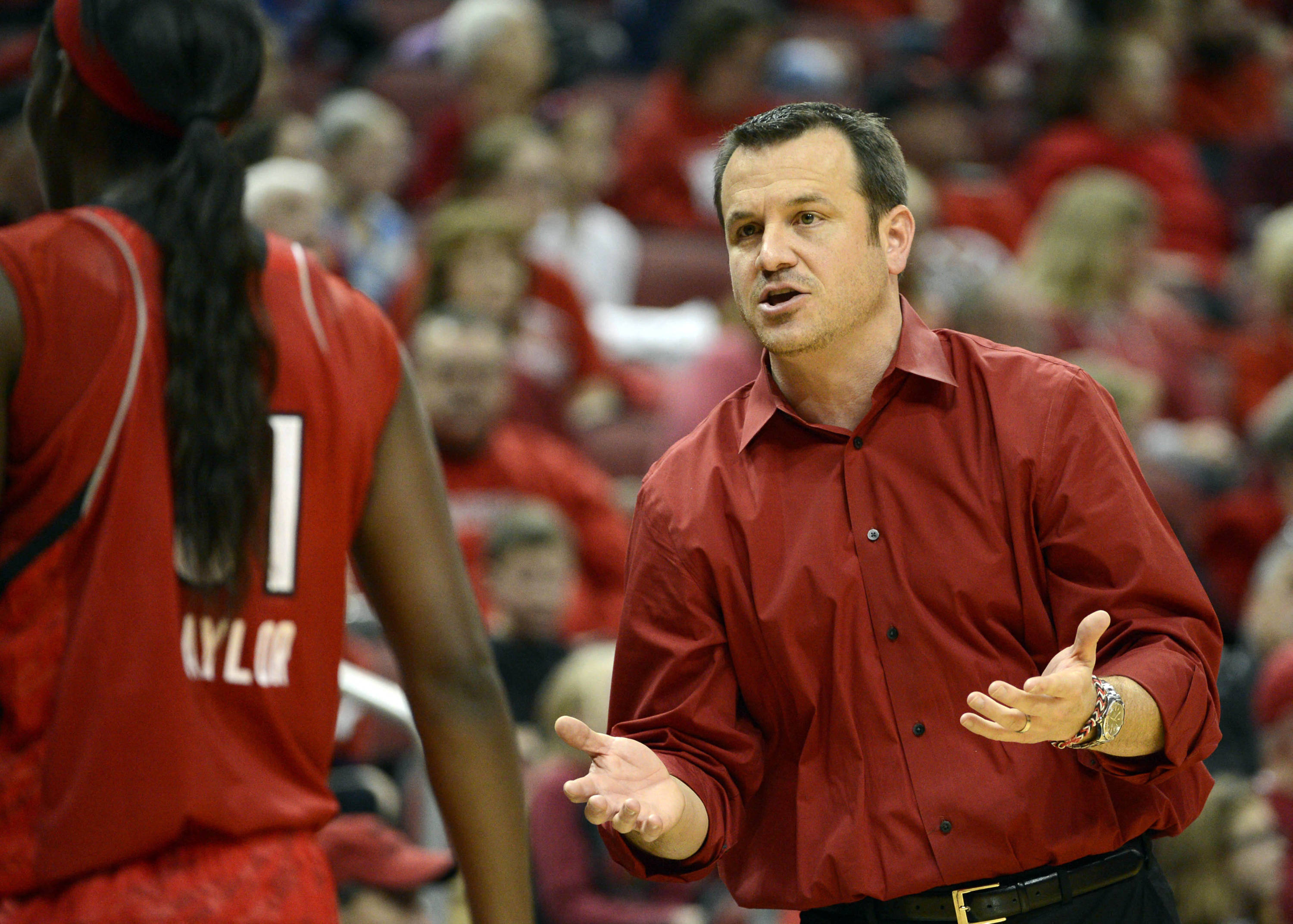 Nov 24, 2013; Louisville, KY, USA; Louisville Cardinals head coach Jeff Walz talks to forward Asia Taylor (31) during the second half against the Florida State Seminoles at KFC YUM! Center. Louisville defeated Florida State 69-59.  Mandatory Credit: Jamie Rhodes-USA TODAY Sports