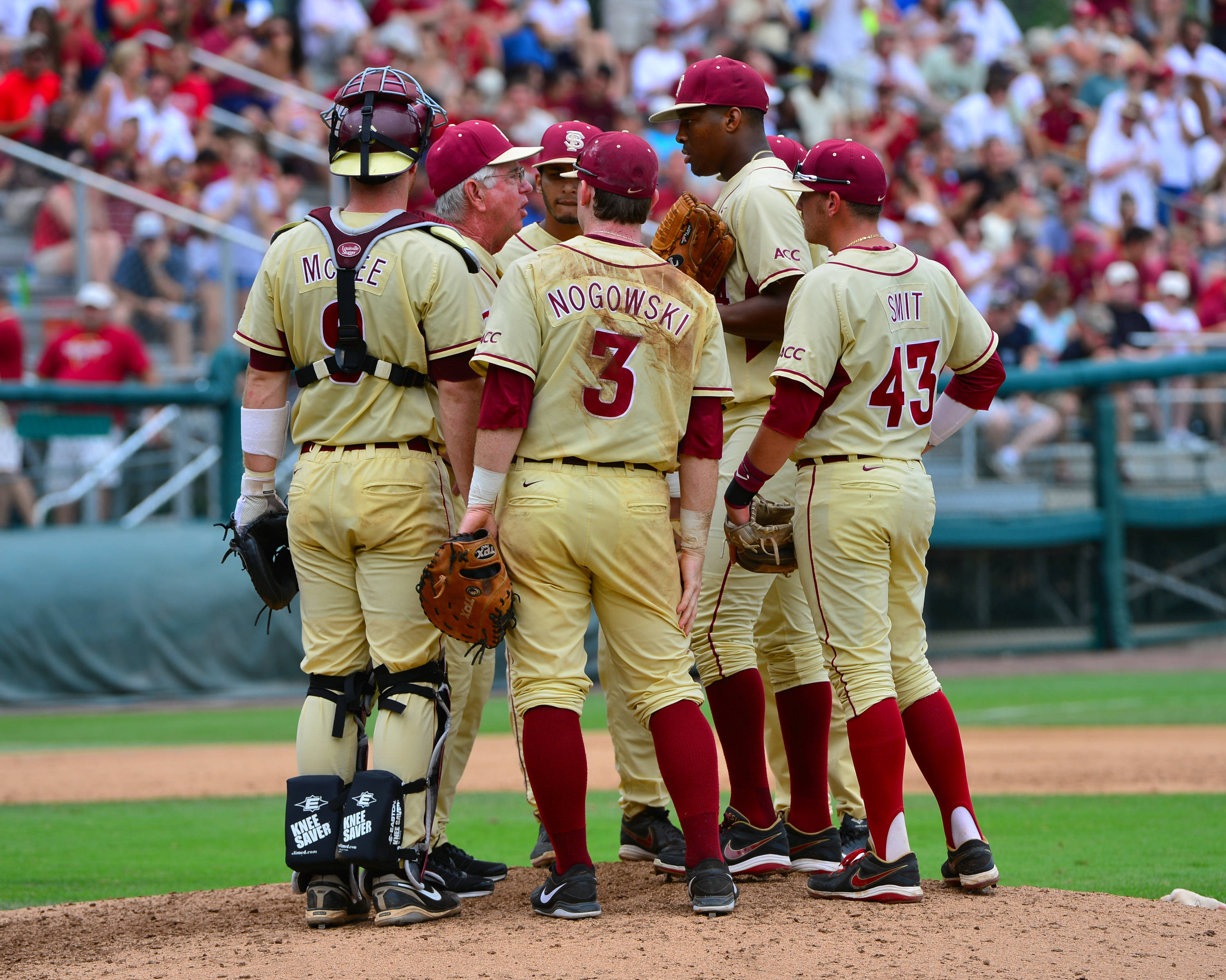 Mike Martin meets with his players at the mound