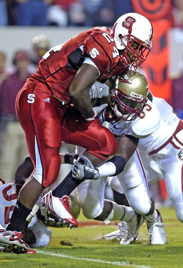 North Carolina State's Andre Brown gets wrapped up by Florida State's Lawrence Timmons in the first half. (AP Photo/Stan Gilliland)