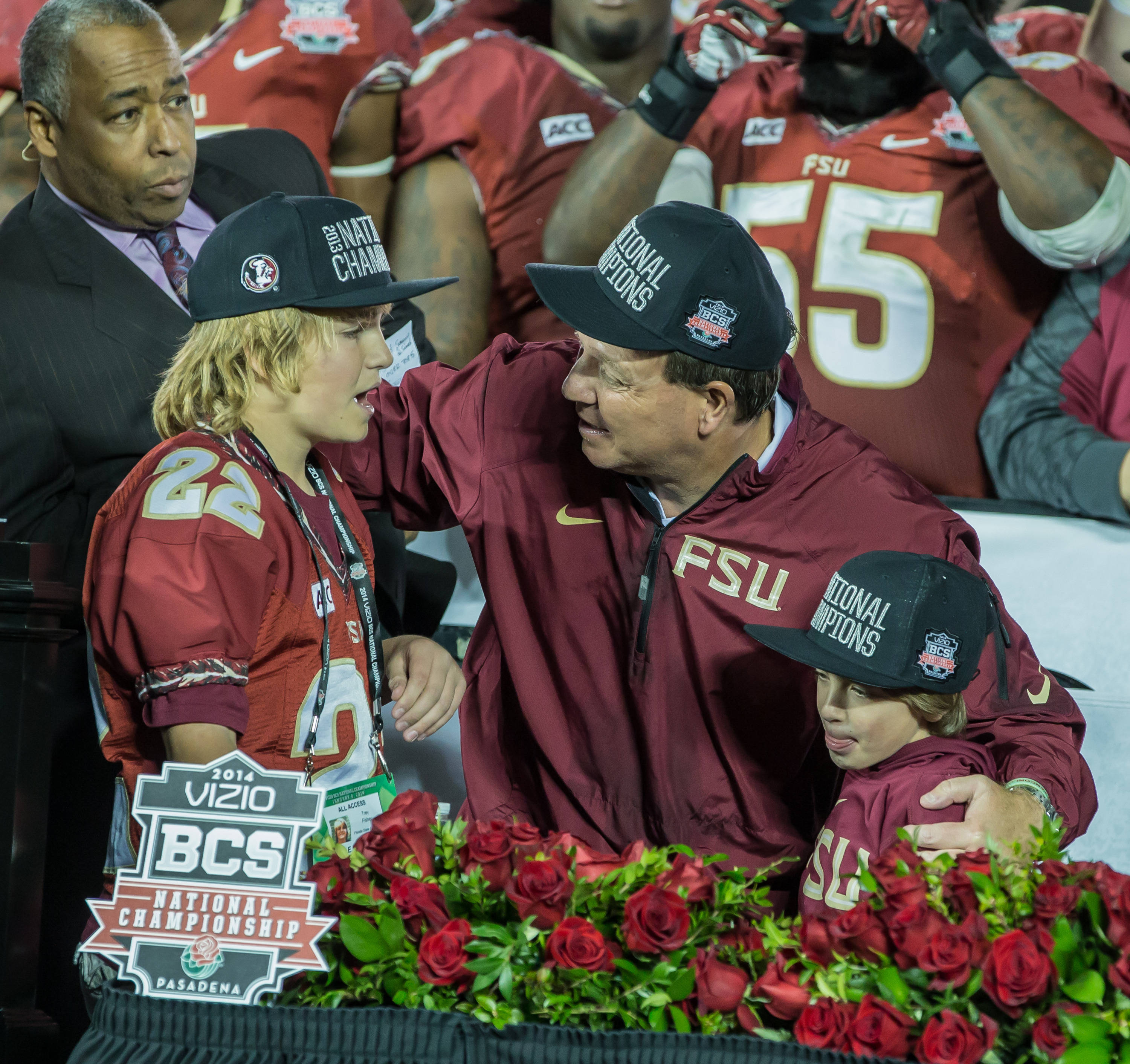 Jimbo Fisher shares a moment with his sons, Trey and Ethan, on the podium after winning the National Championship.
