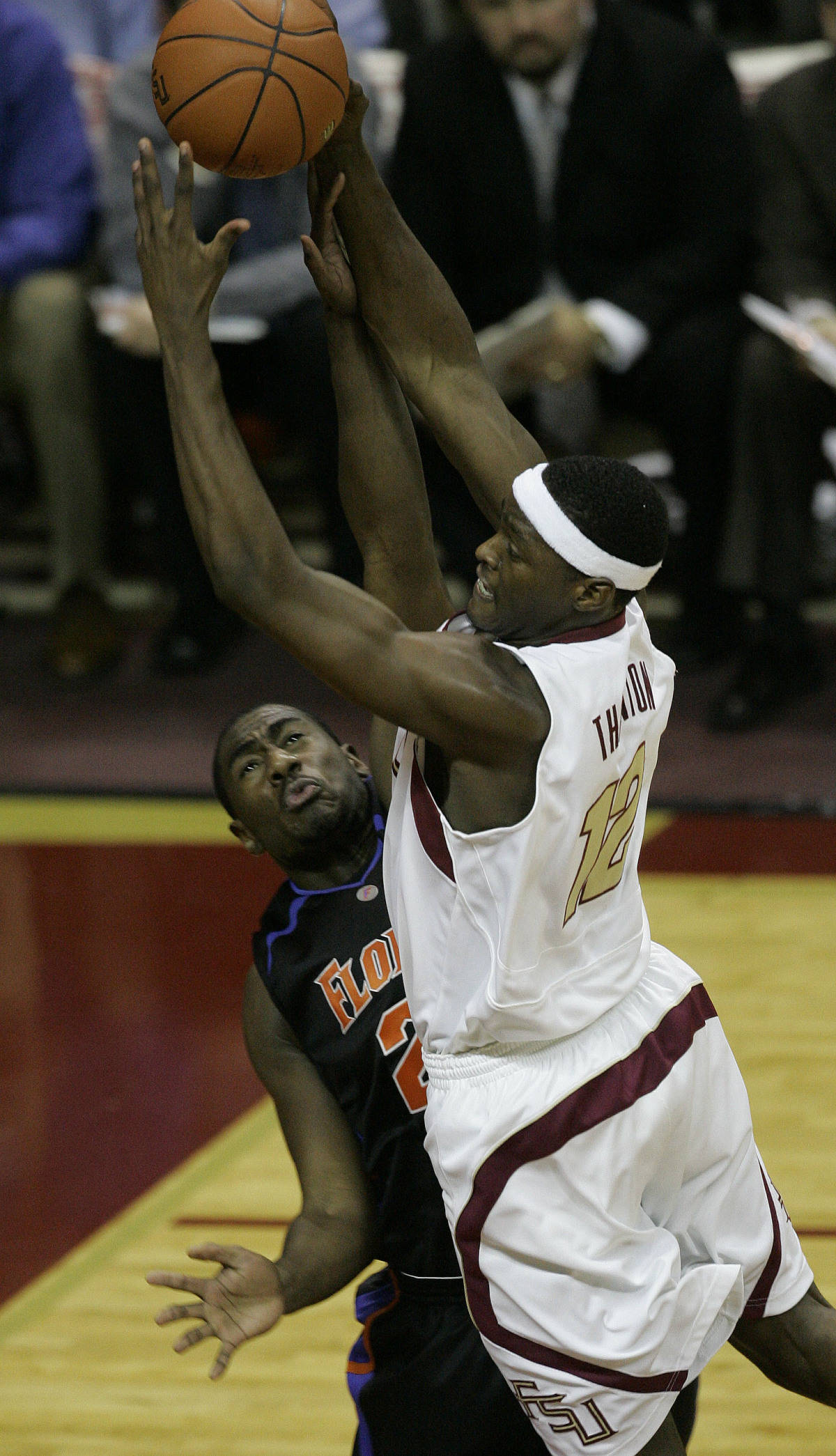Florida State's Al Thornton, right, drives to the basket despite the defensive efforts of Florida's Jonathan Mitchell, left, during the first half of a college basketball game, Sunday, Dec. 3, 2006, in Tallahassee, Fla.(AP Photo/Phil Coale)