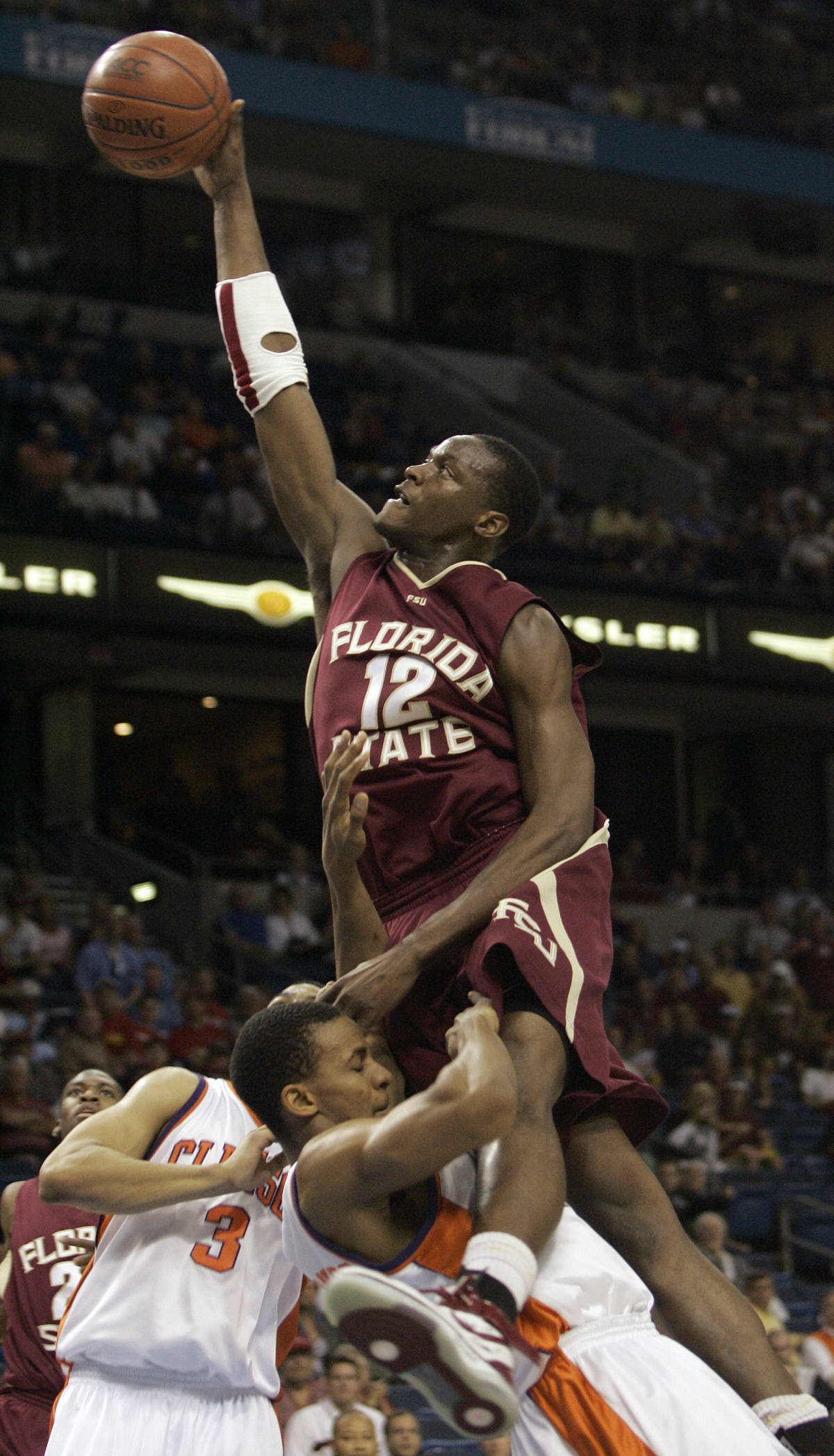 Florida State's Al Thornton (12) drives over Clemson's Cliff Hammonds (25) during the first half of a first round game of the Men's Atlantic Coast Conference basketball tournament in Tampa, Fla., Thursday, March 8, 2007. (AP Photo/David J. Phillip)