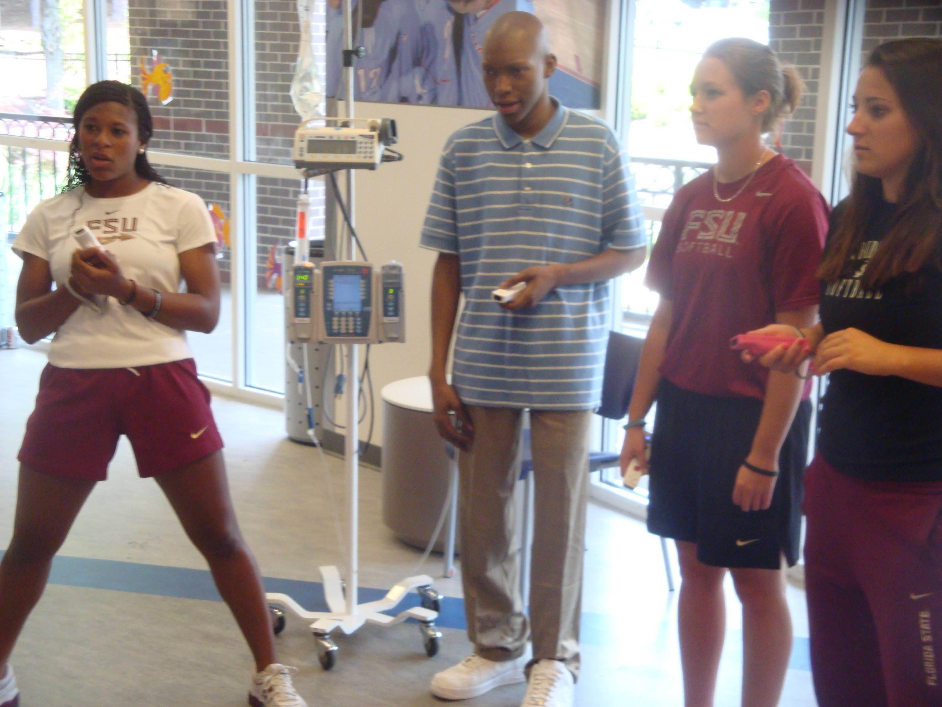 Today was Doc's 18th birthday! Tiffani Brown (L), Mallory Borden and Lauren Mullins celebrated with him by playing some Wii Olympics - It brought out the best in each player!