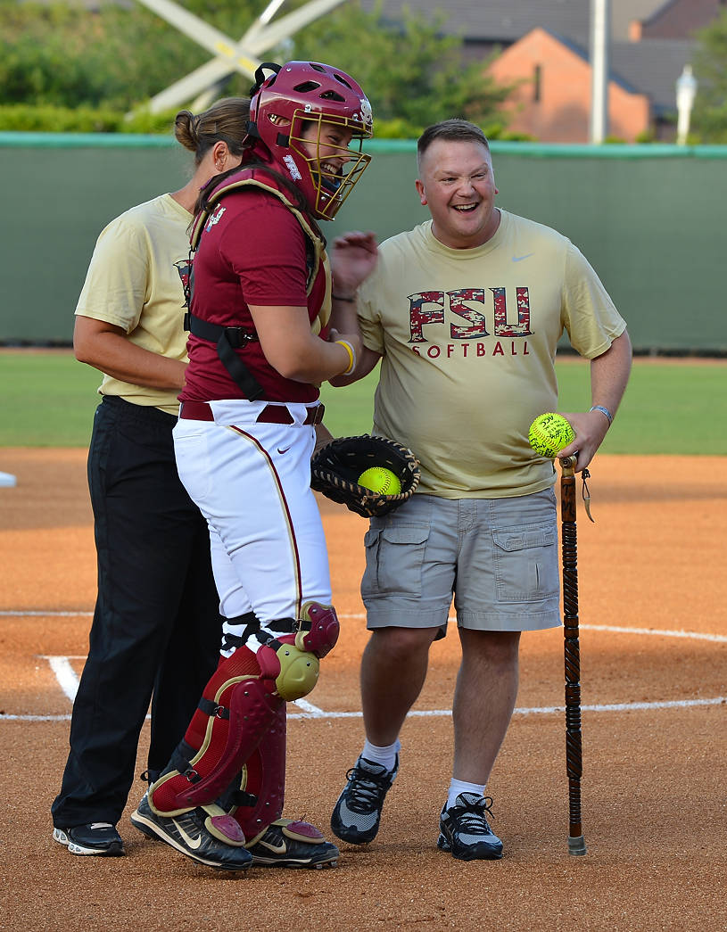 Tom Marcum celebrates with Erika Leonard and head coach Lonni Alameda
