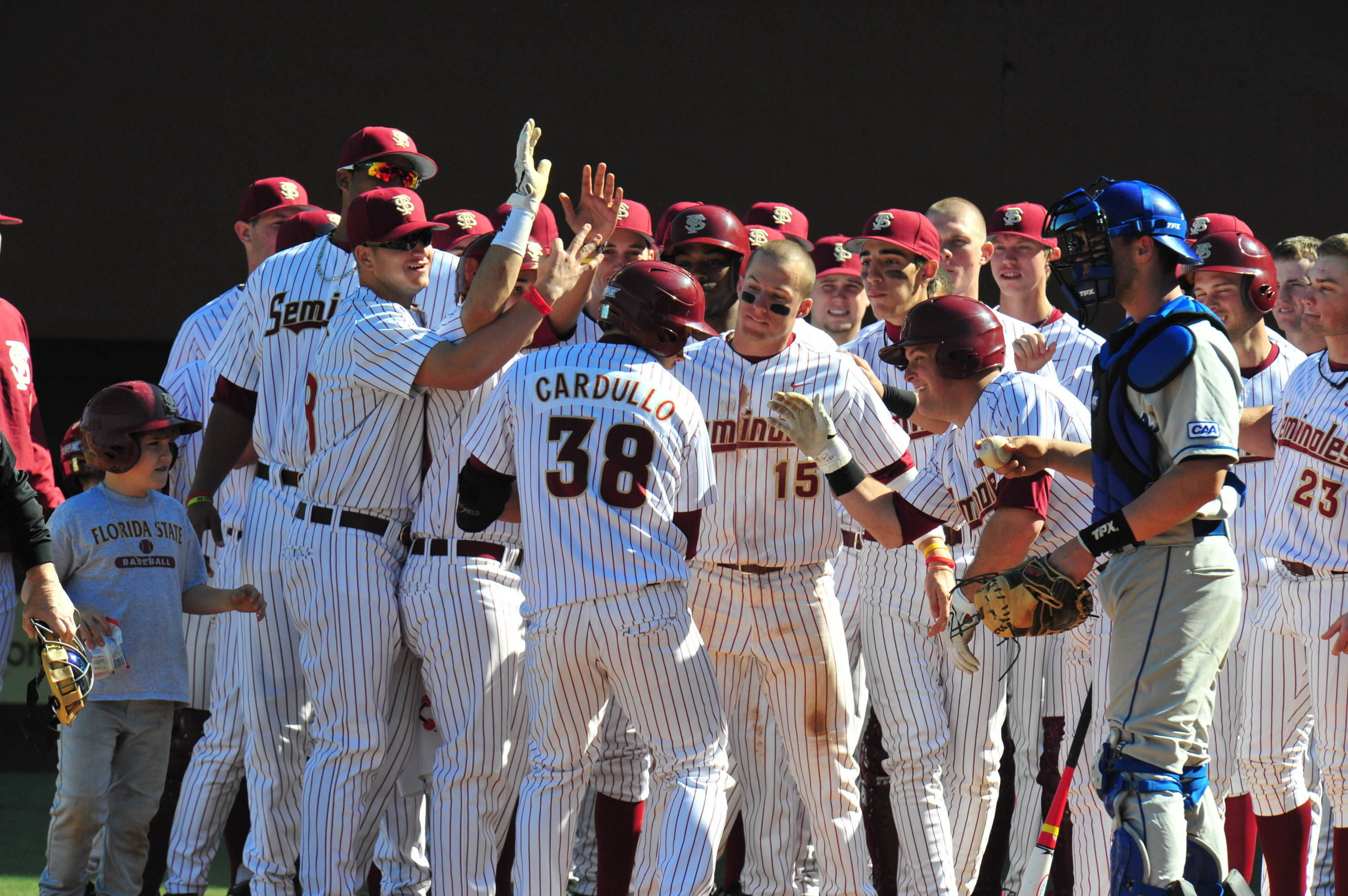 Cardullo celebrates with teammates after hitting a three-run shot in the second inning.
