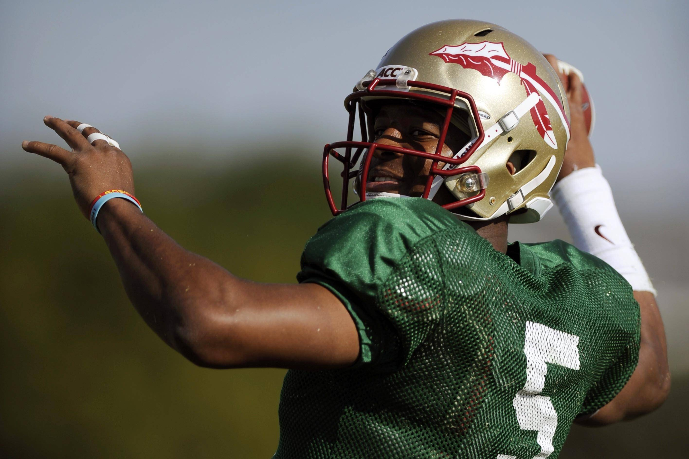 Jan 3, 2014; Orange, CA, USA; Florida State Seminoles quarterback Jameis Winston (5) during practice for the BCS National Championship football game against the Auburn Tigers at Orange Coast College. Mandatory Credit: Kelvin Kuo-USA TODAY Sports