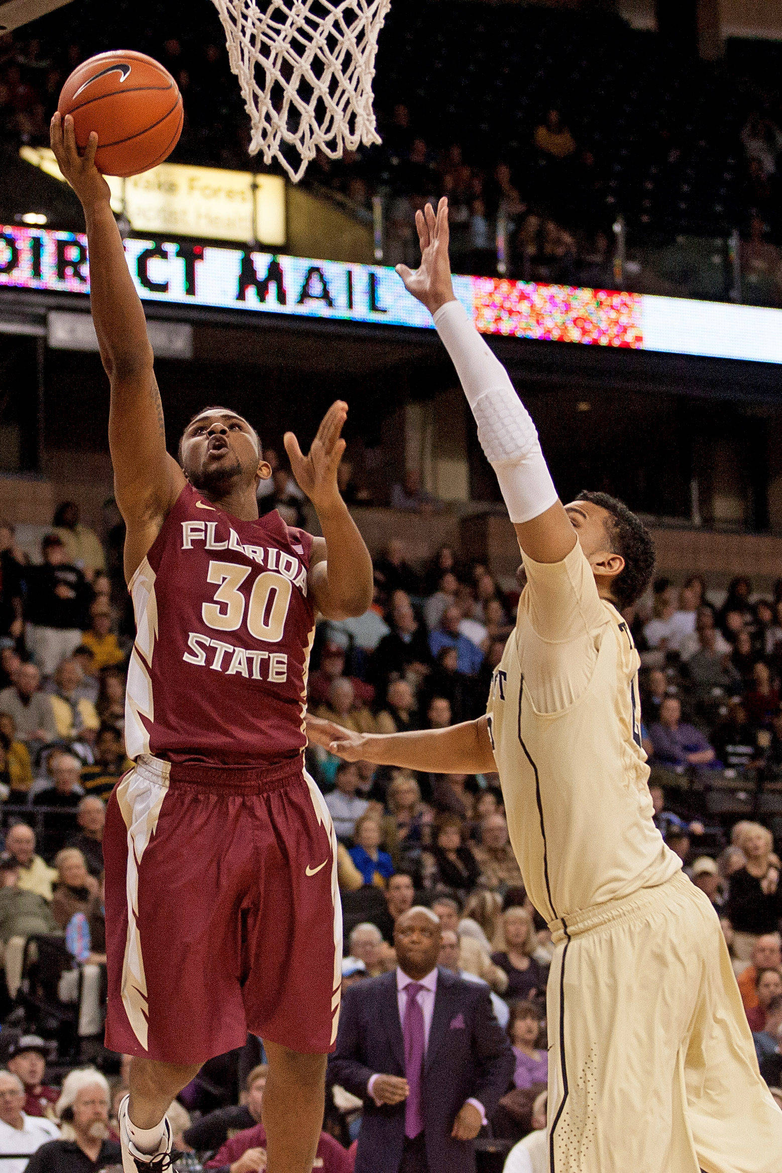 Florida State Seminoles guard Ian Miller (30) goes up for a shot while Wake Forest Demon Deacons forward Devin Thomas (2) defends. (Jeremy Brevard-USA TODAY Sports)