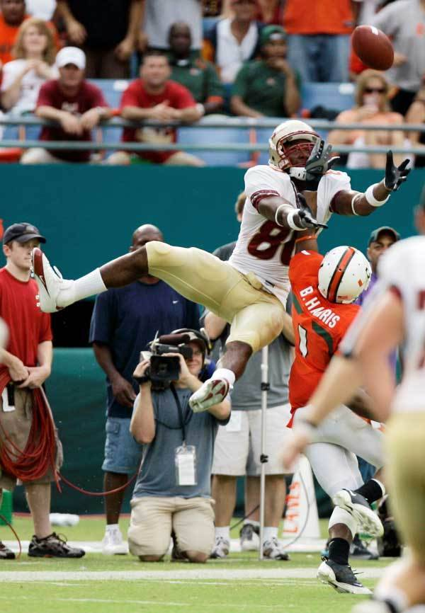 Florida State's Jarmon Forston (80) is unable to catch a pass as Miami's Brandon Harris (1) is charged with pass interference during the first half.