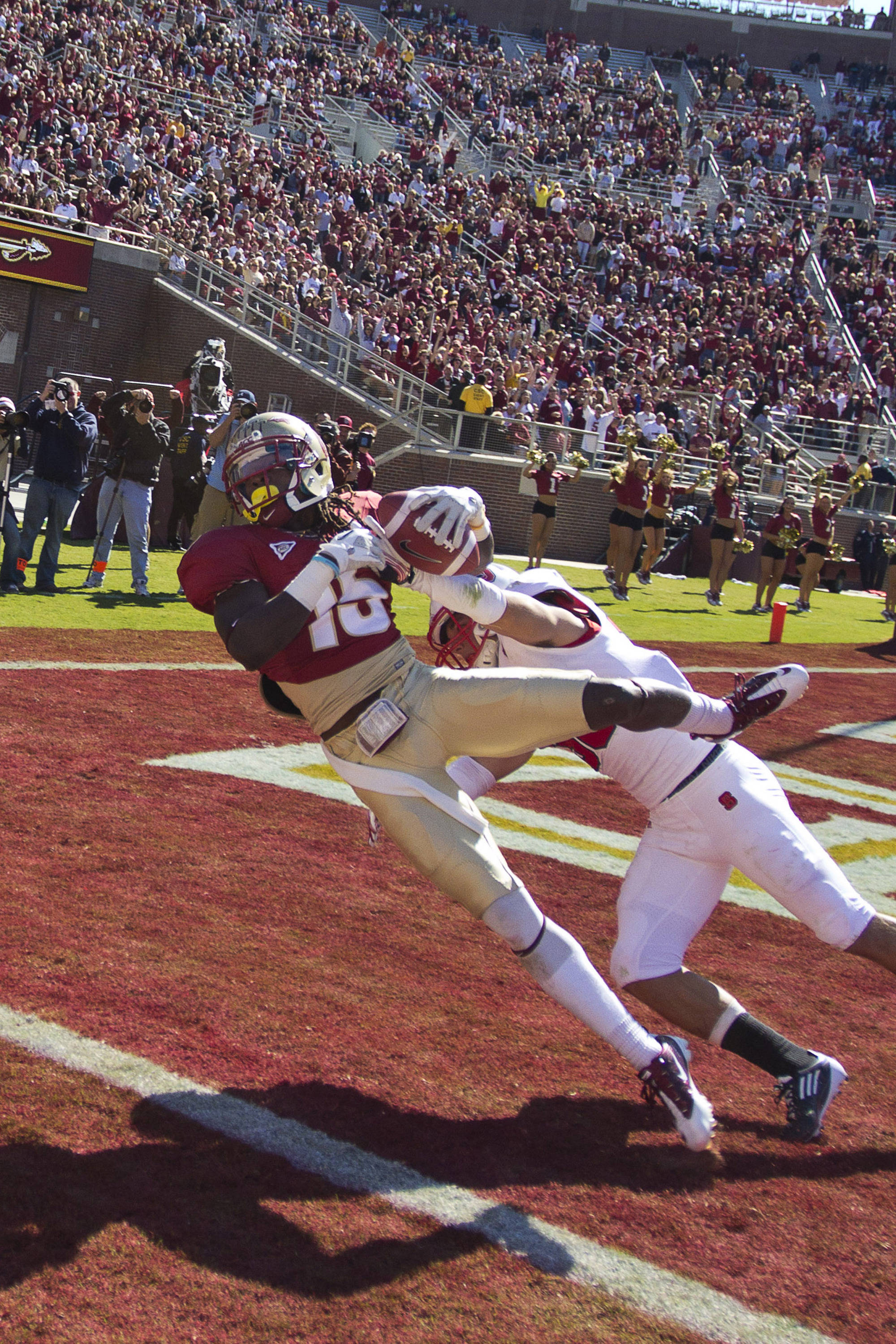 Greg Dent (15) gets a foot in the end zone to score after making a jumping catch during the football game against NC State on October 29, 2011.