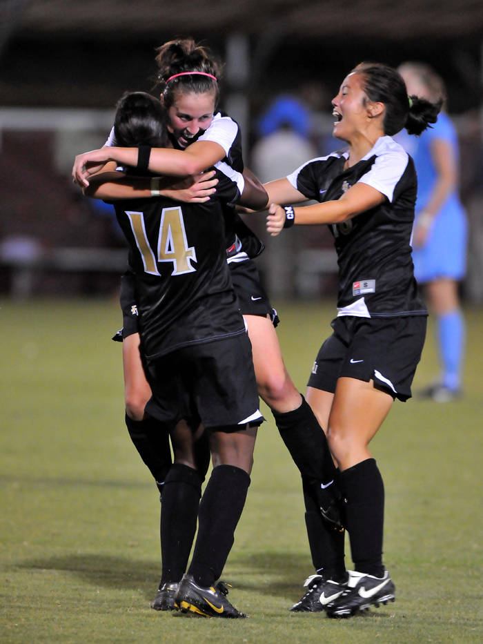 The Seminoles celebrate after Amanda DaCosta's game-tying goal in the 85th minute.
