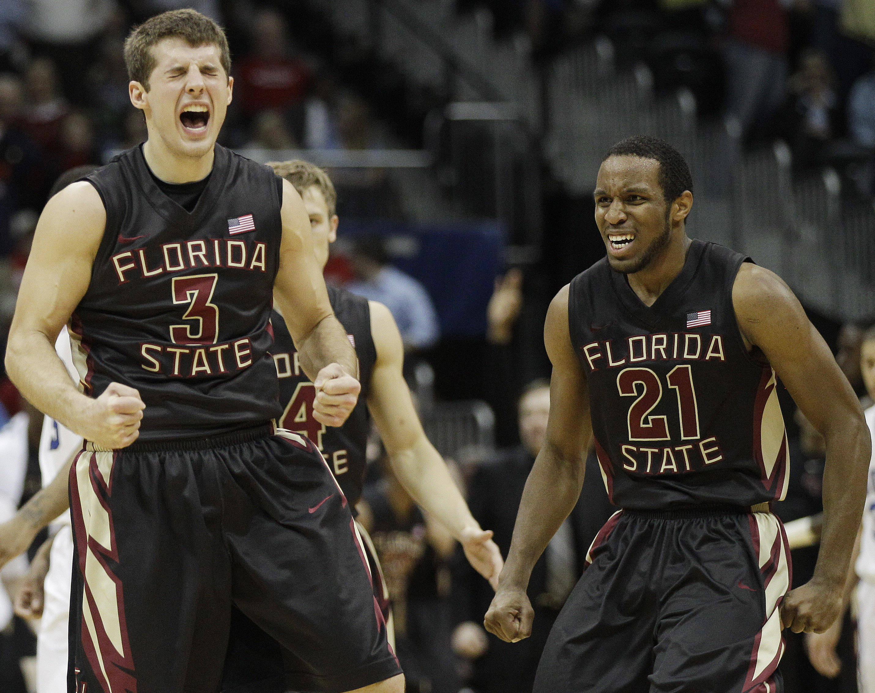 Florida State guard Luke Loucks (3) and guard Michael Snaer (21) after Loucks made the last basket of the game against Duke late in the second half of an NCAA college basketball game in the semifinals of the Atlantic Coast Conference tournament, Saturday, March 10, 2012, in Atlanta. Florida State won 62-59. (AP Photo/Chuck Burton)