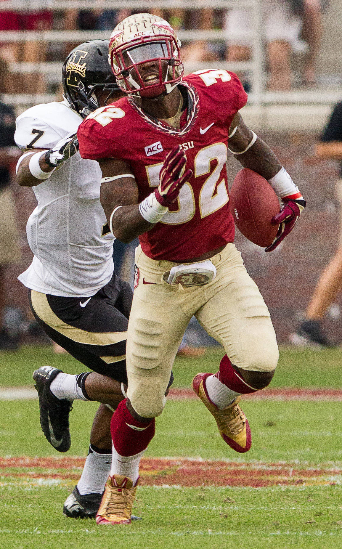 James Wilder, Jr. (32) carries the ball during FSU Football's 80-14 victory over Idaho in Tallahassee, Fla on Saturday, November 23, 2013. Photos by Mike Schwarz.