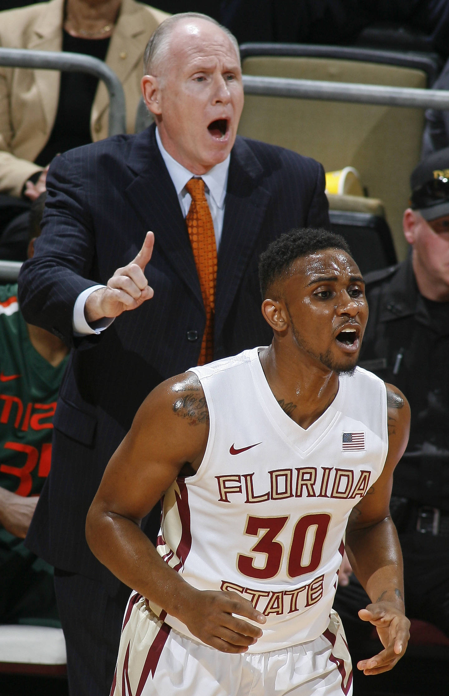 Feb 10, 2014; Tallahassee, FL, USA; Miami Hurricanes Head Coach Jim Larranaga  calls a play as Seminoles guard Ian Miller (30) reacts in the first half. Phil Sears-USA TODAY Sports
