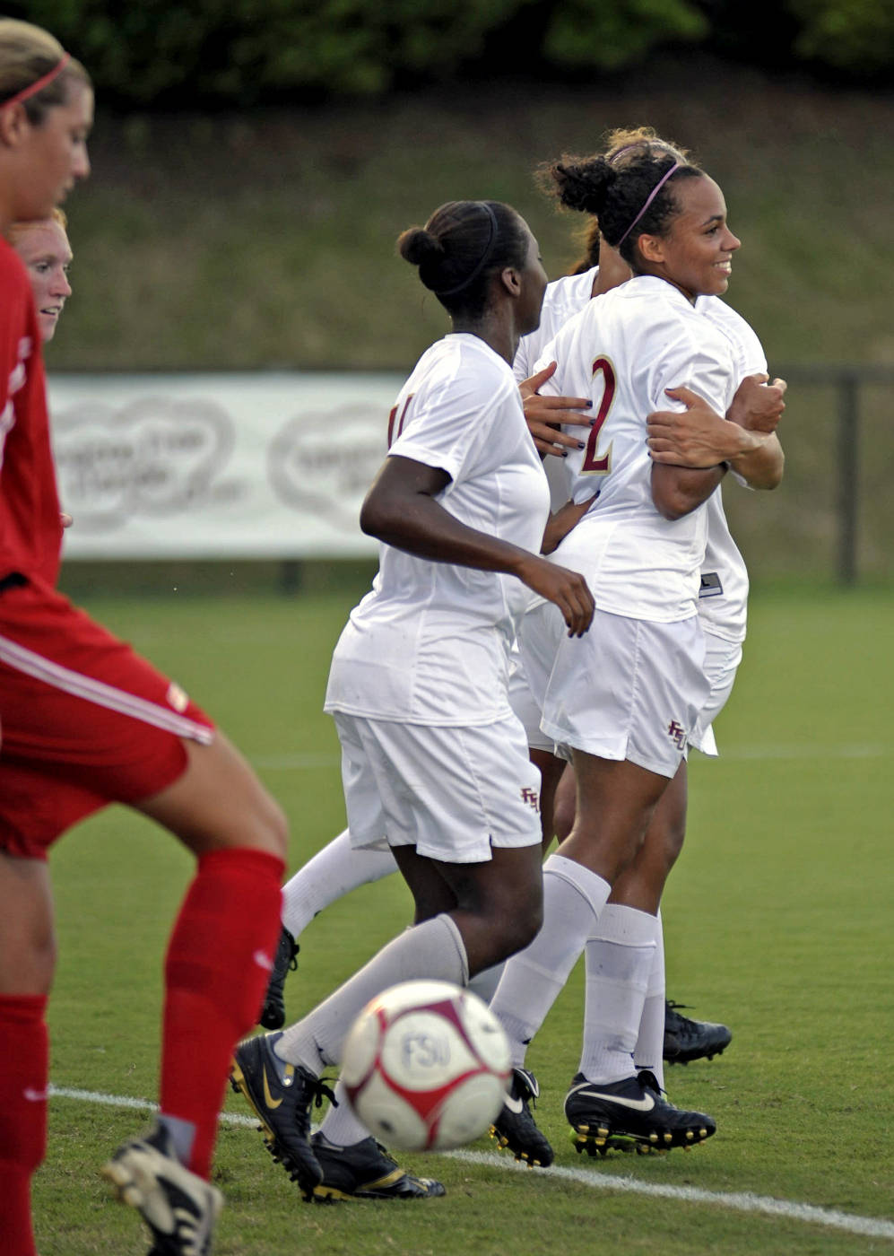 The Seminoles celebrate after a goal.