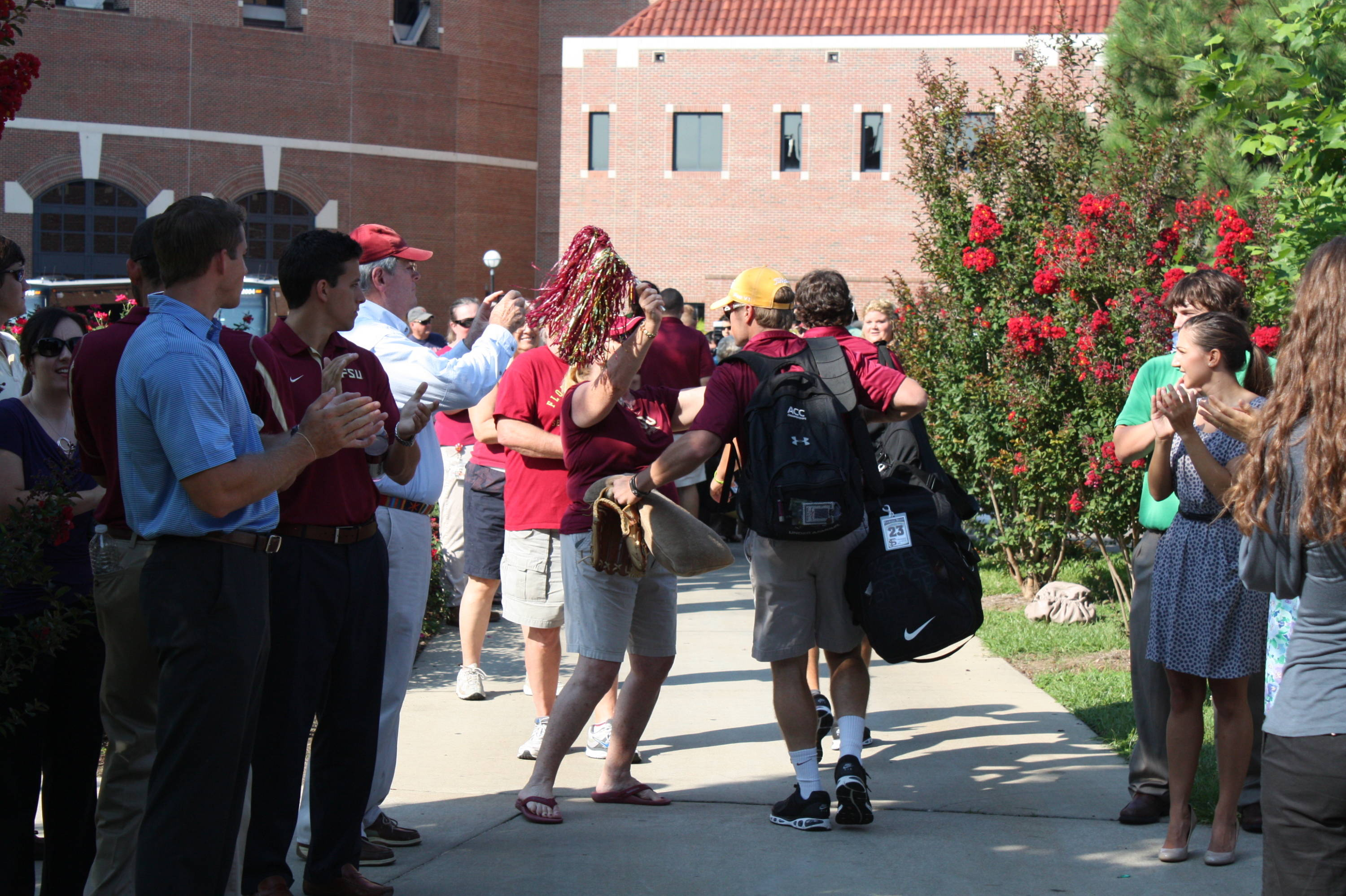 James Ramsey receives a hug from a fan outside Dick Howser Stadium before the team leaves for the airport.