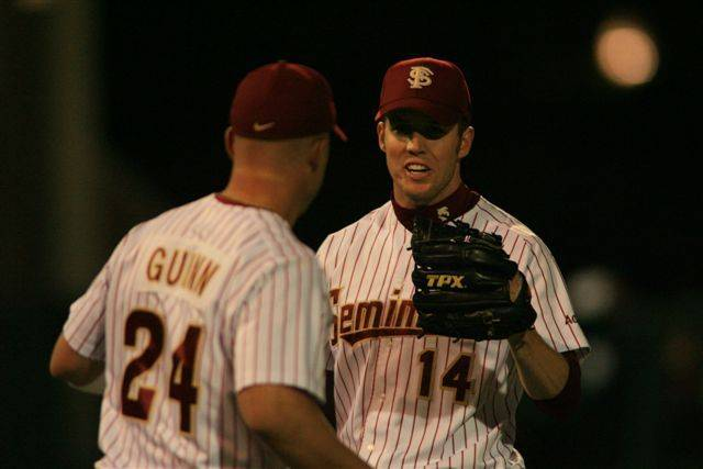 Dennis Guinn congratulates Ryan Strauss on his first career complete.