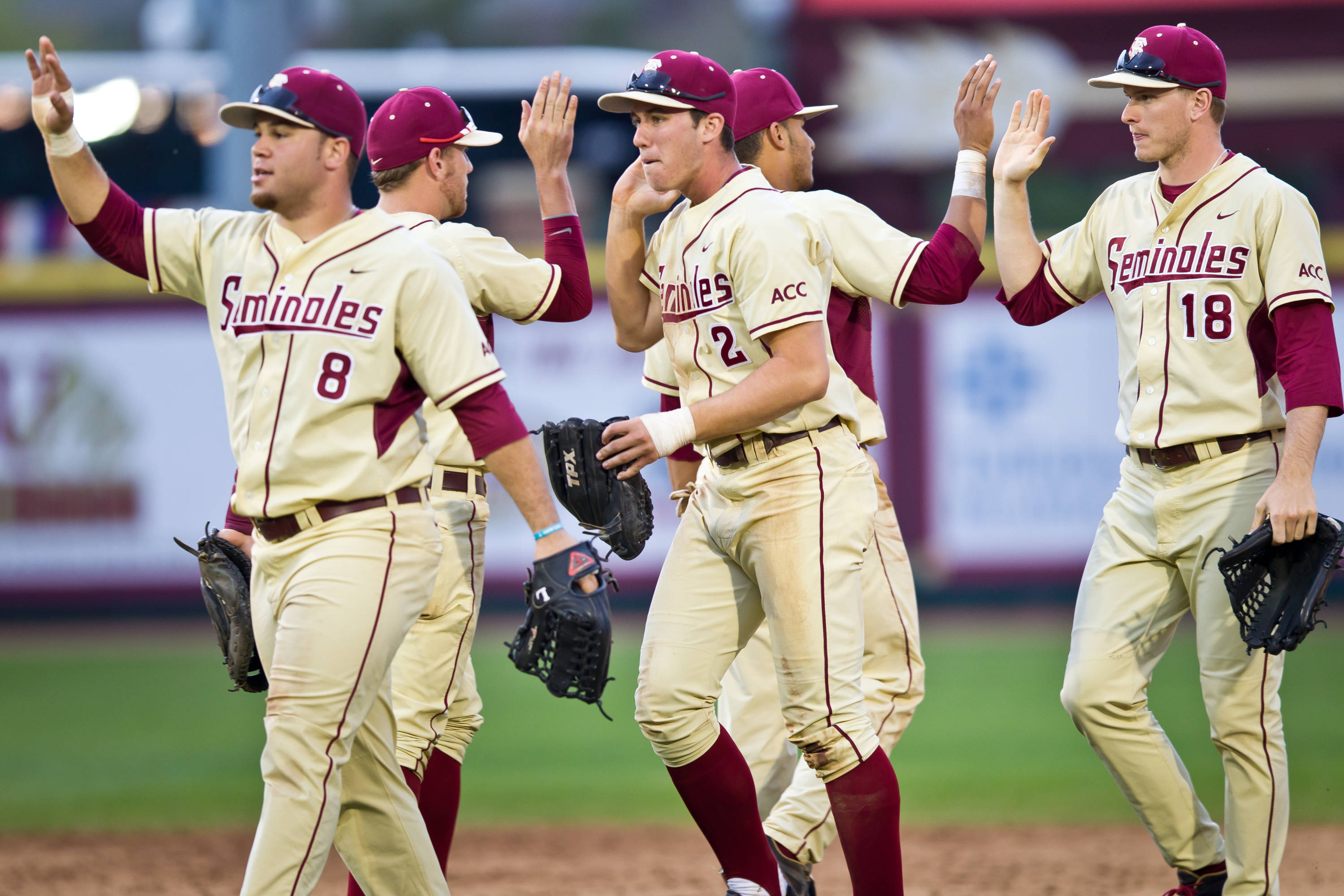 The Seminoles celebrate their series sweep of USF.