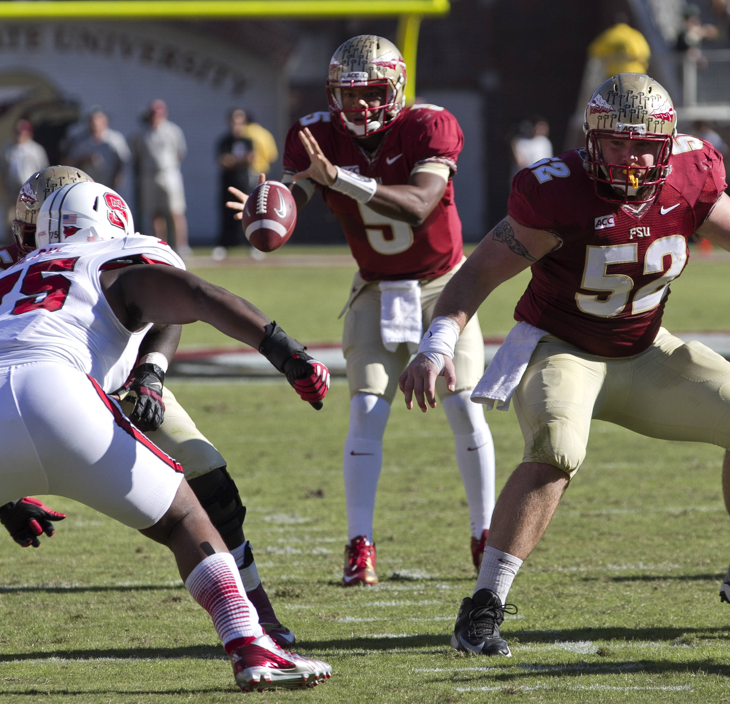 Jameis Winston (5), Bryan Stork (52), FSU vs NC State,  10-26-13, (Photo by Steve Musco)