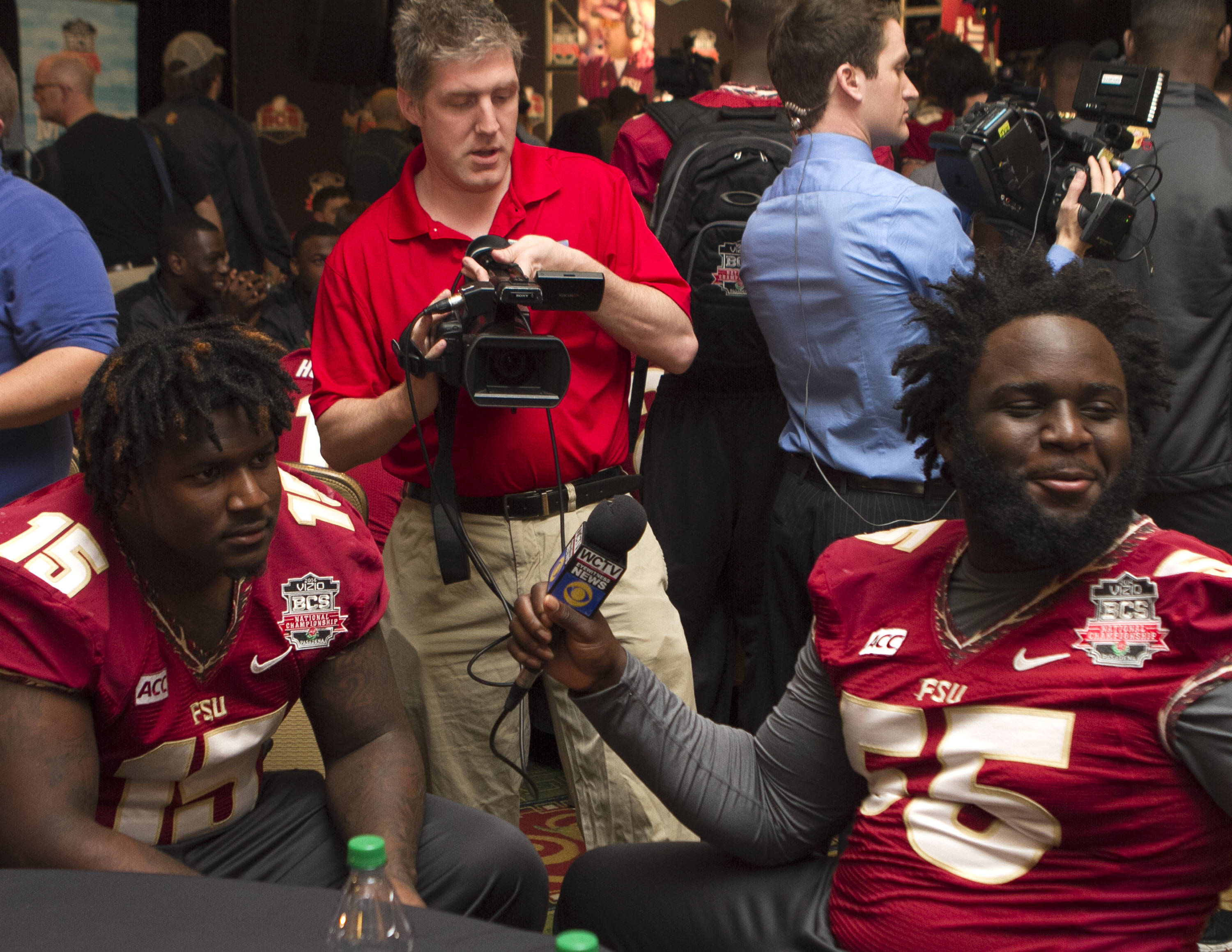 Jacobbi McDaniel (55) interviewing Mario Edwards, Jr. (15), FSU at BCS Championship Media Day,  1-04-14,  (Photo by Steve Musco)
