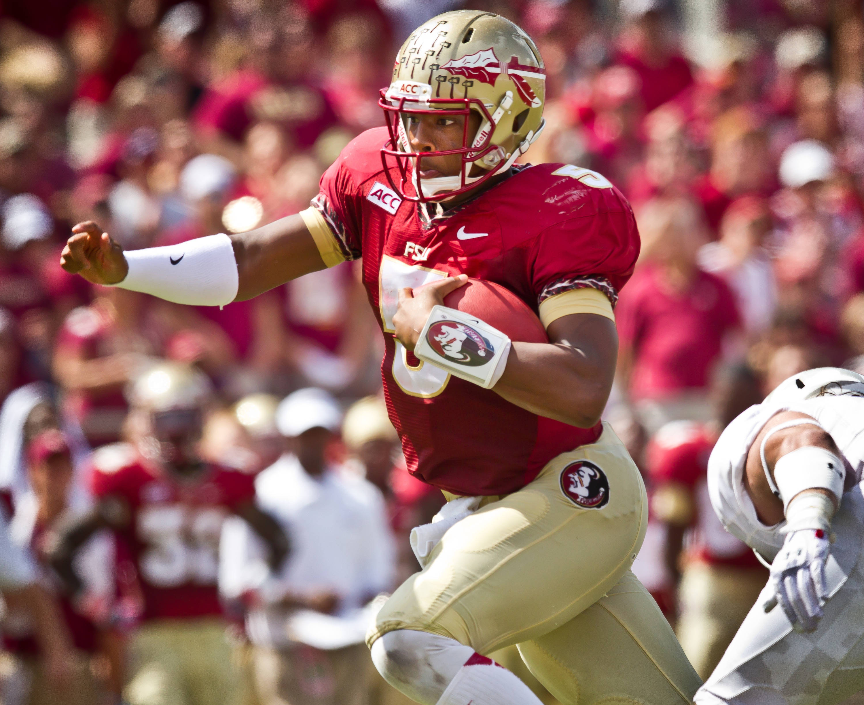 Jameis Winston (5) scrambles for yardage.
