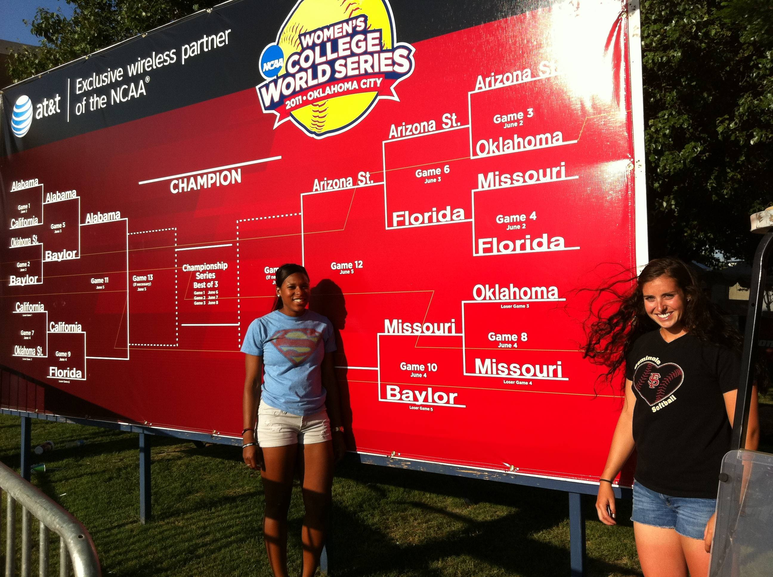 Tiffani Brown and Maddie O'Brien stand before the bracket