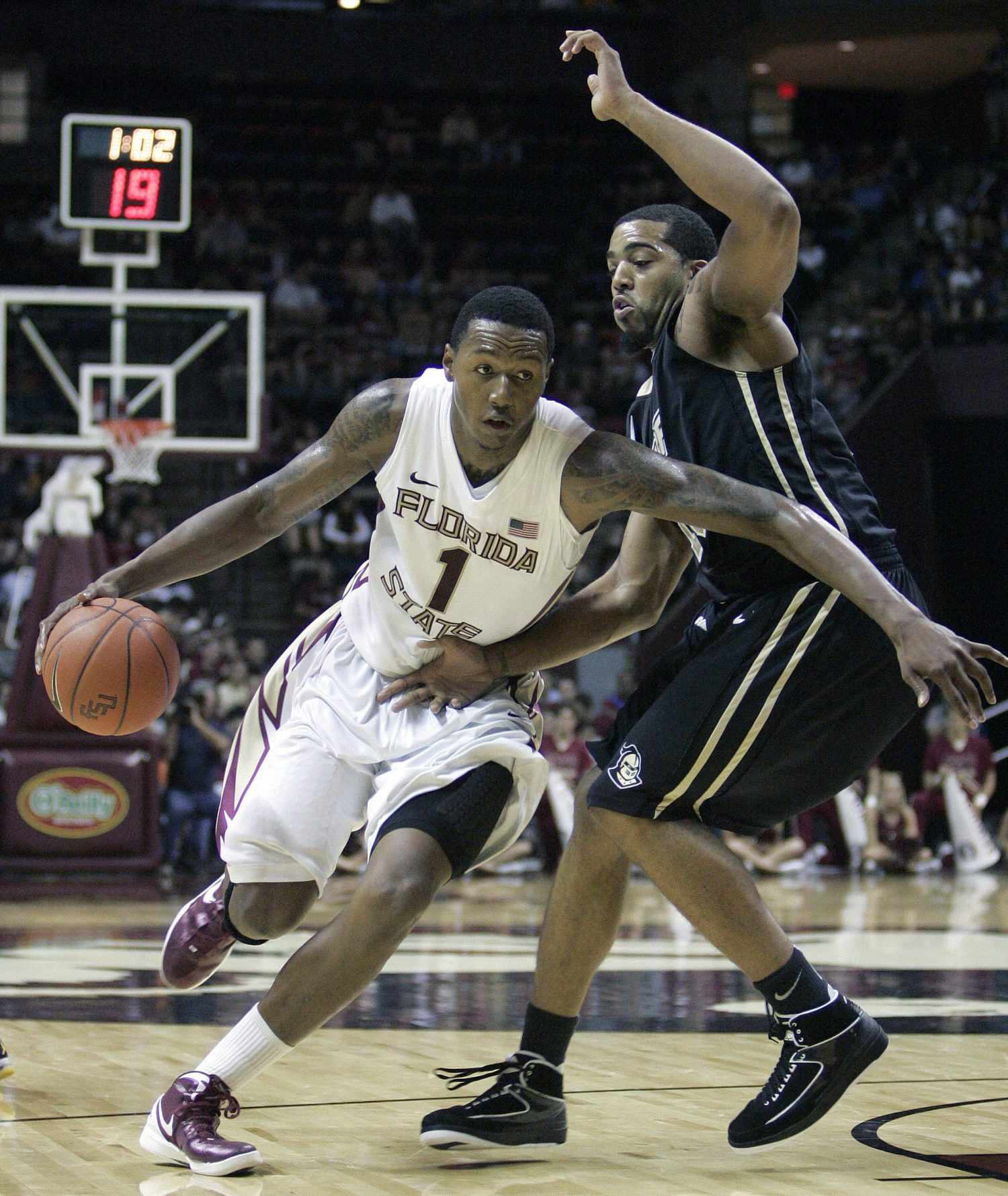Florida State's Xavier Gibson drives against the defense of  Central Florida's Dwight McCombs in the first half of an NCAA college basketball game which Florida State won 73-50 on Monday, Nov. 14, 2011, in Tallahassee, Fla.(AP Photo/Steve Cannon)