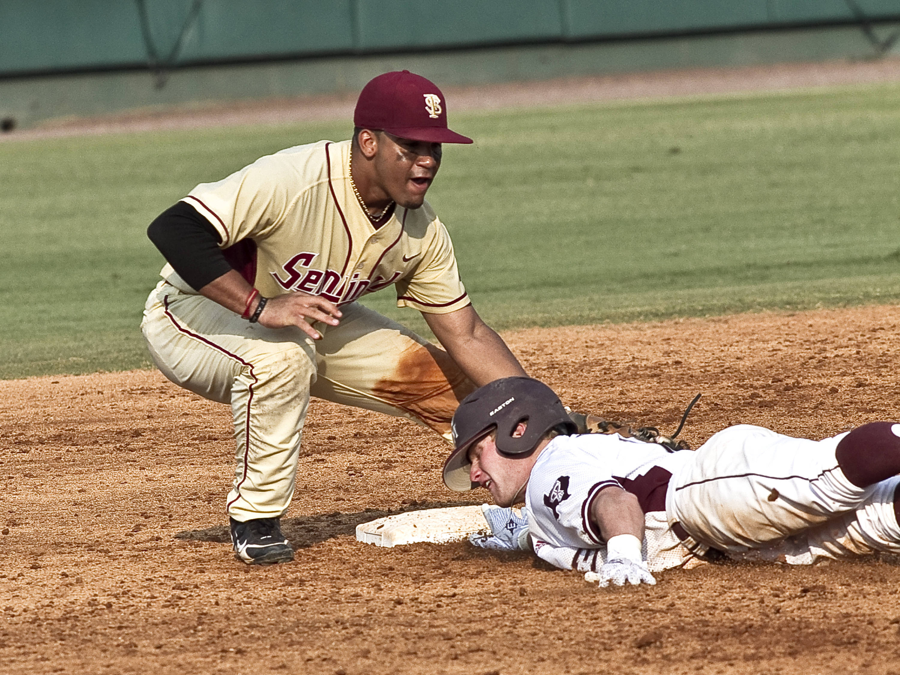 Devon Travis (8) putting the tag on a Texas A&M runner in an attempted pick-off.