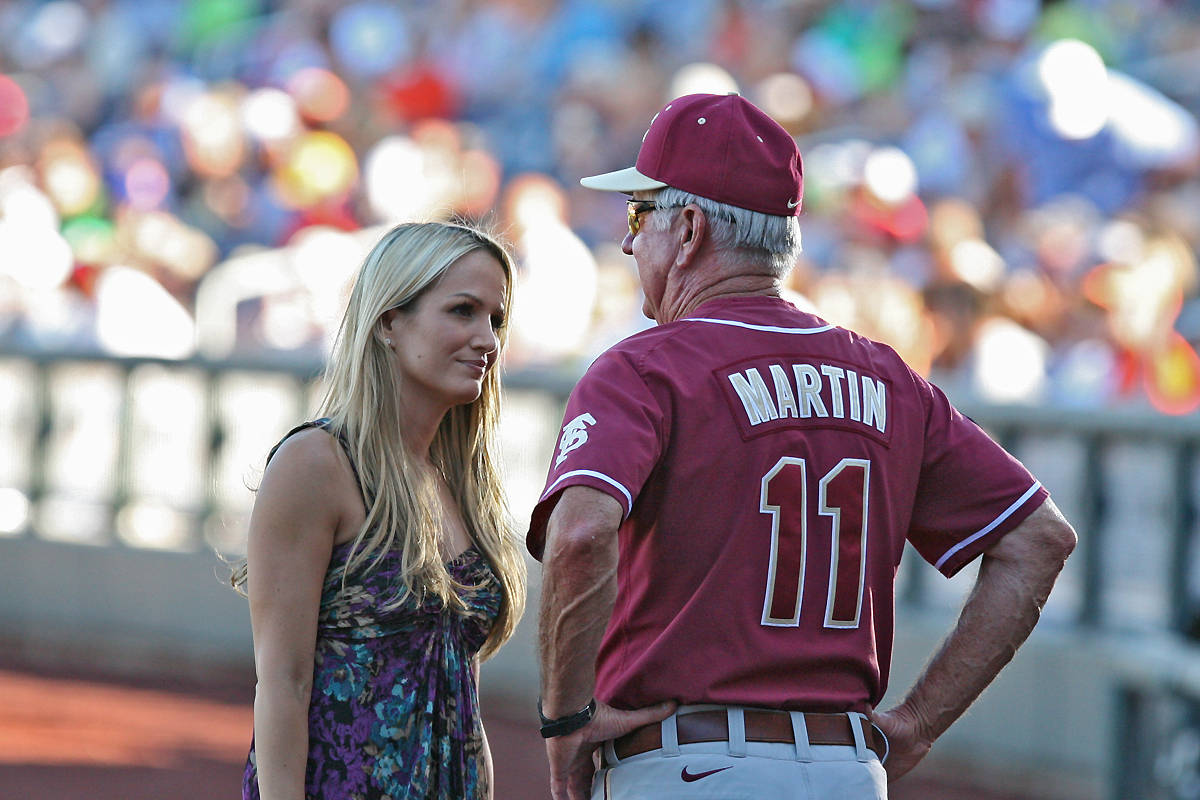 ESPN's Jenn Brown speaks with FSU head coach Mike Martin during the fifth inning.