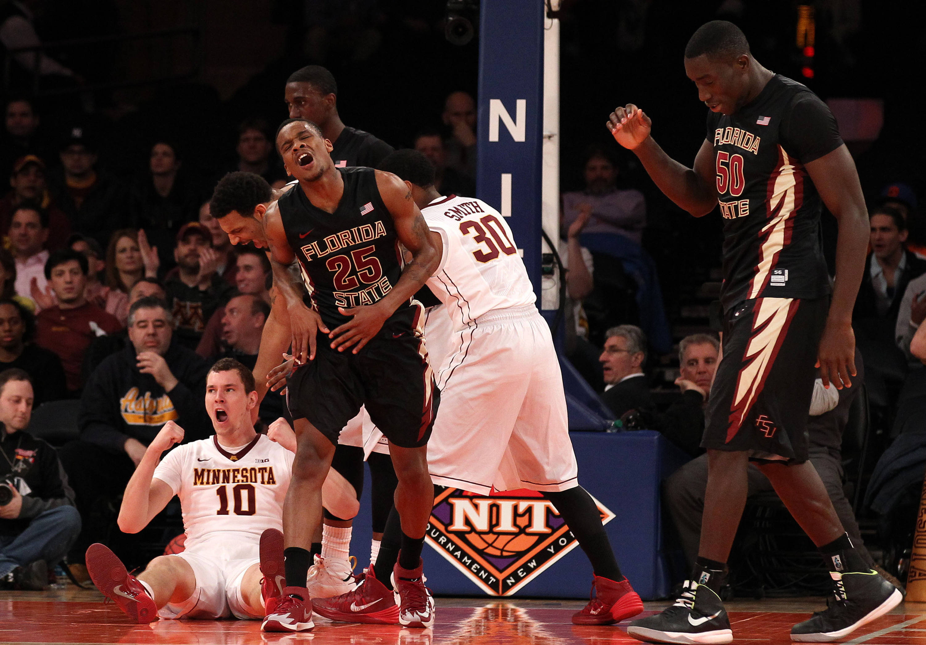 Apr 1, 2014; New York, NY, USA; Florida State Seminoles guard Aaron Thomas (25) reacts to being called for a foul on Minnesota Golden Gophers forward Oto Osenieks (10) during the first half at Madison Square Garden. Mandatory Credit: Adam Hunger-USA TODAY Sports