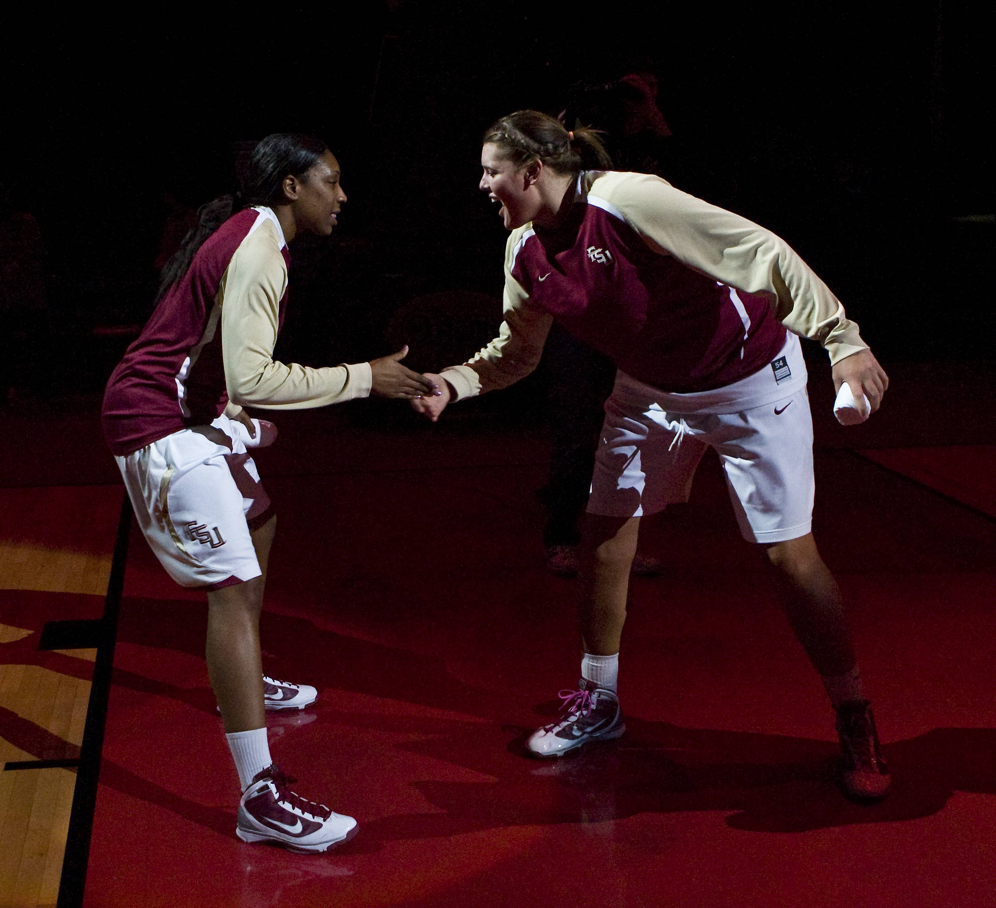 August 12 ... Chasity Clayton and Cierra Bravard get pumped up before a game last year. Both players return this year and will be counted on to help carry the 'Noles to the postseason for the seventh-straight season.