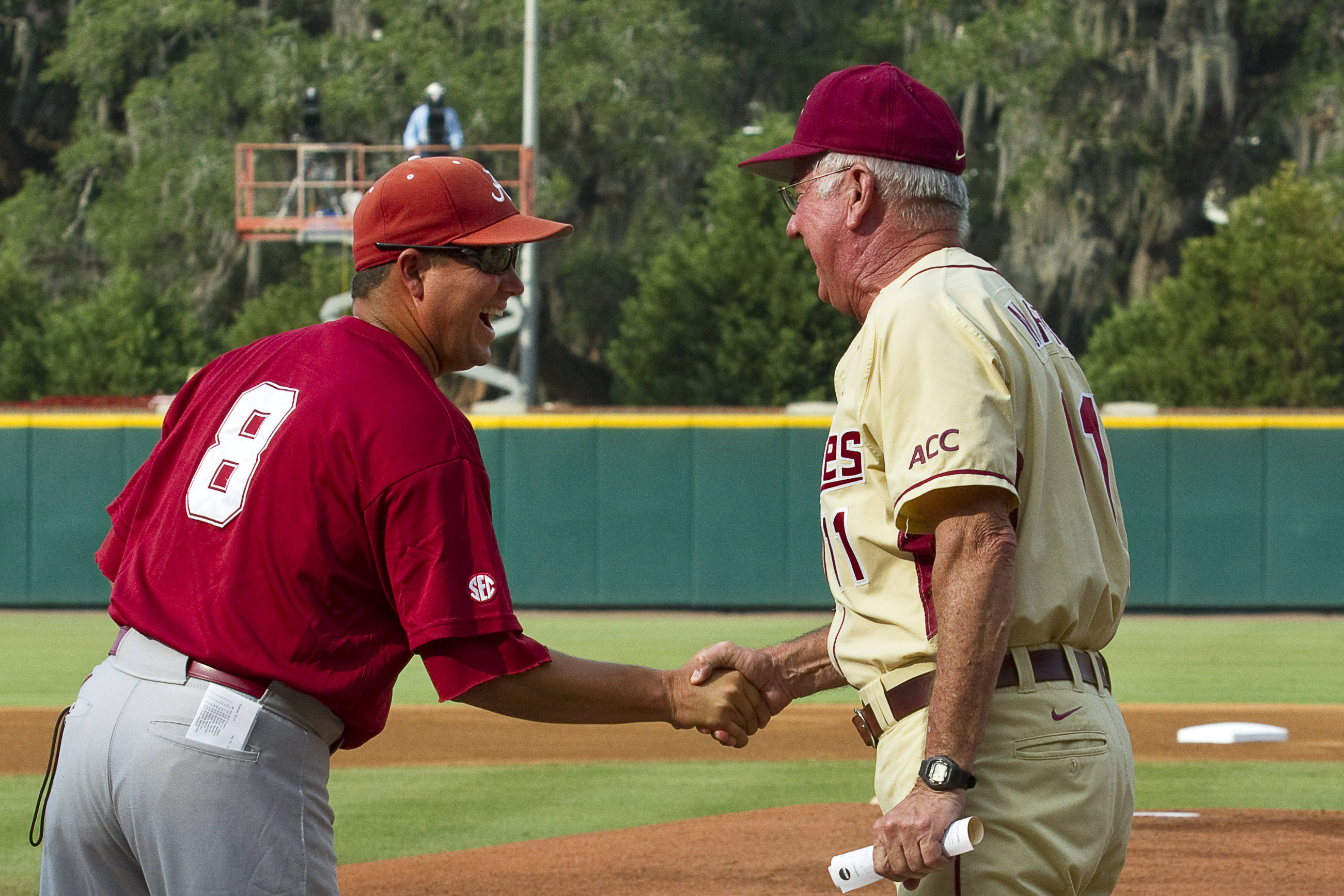 Mike Martin shakes hands with Alabama head coach Mitch Gaspard.