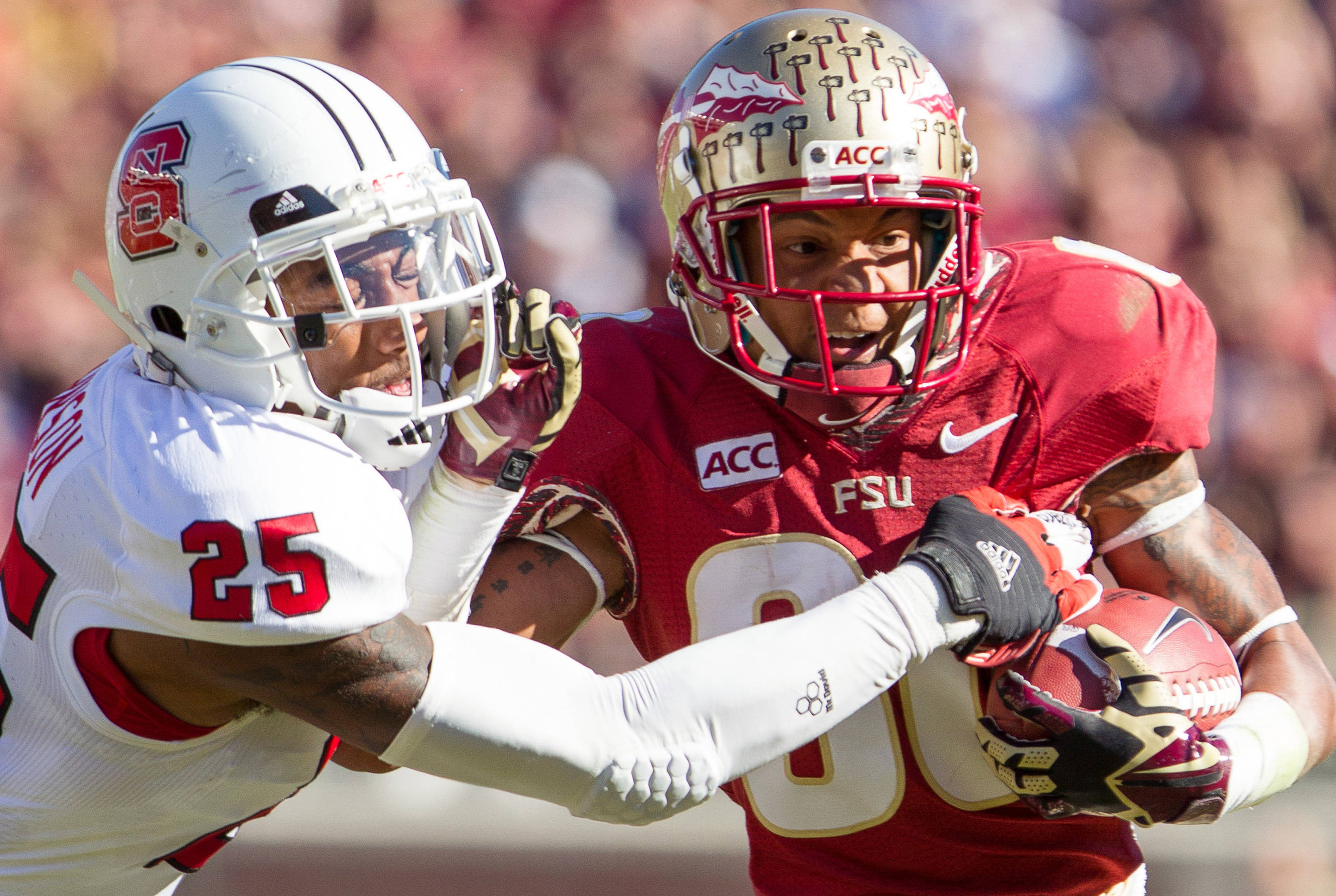 Rashad Greene (80) runs the ball during FSU Football's 49-17 win over NC State on Saturday, October 26, 2013 in Tallahassee, Fla. Photo by Michael Schwarz.