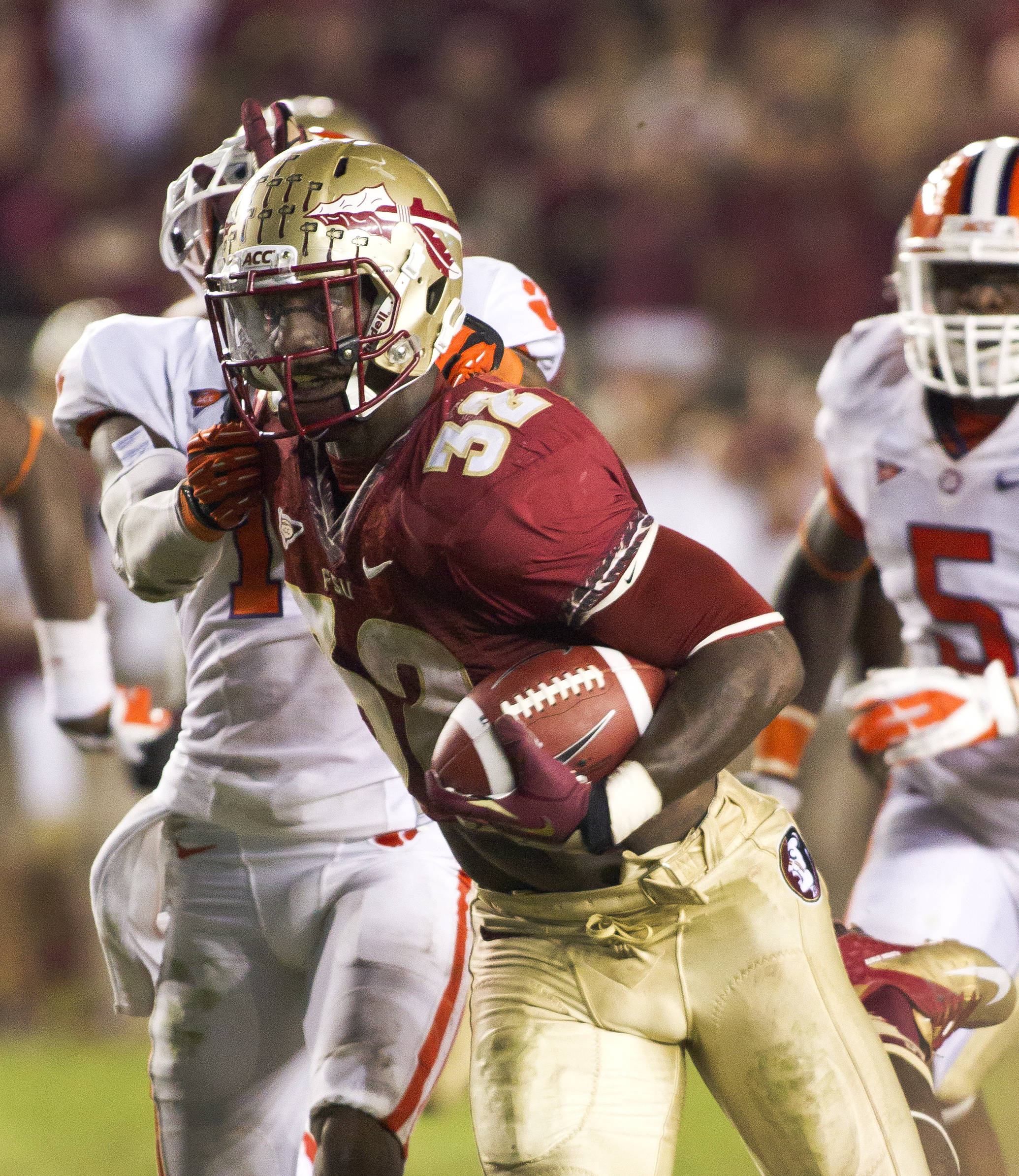 James Wilder Jr. (32) breaking free from a defender on his touchdown run, FSU vs Clemson, 9/22/12 (Photo by Steve Musco)