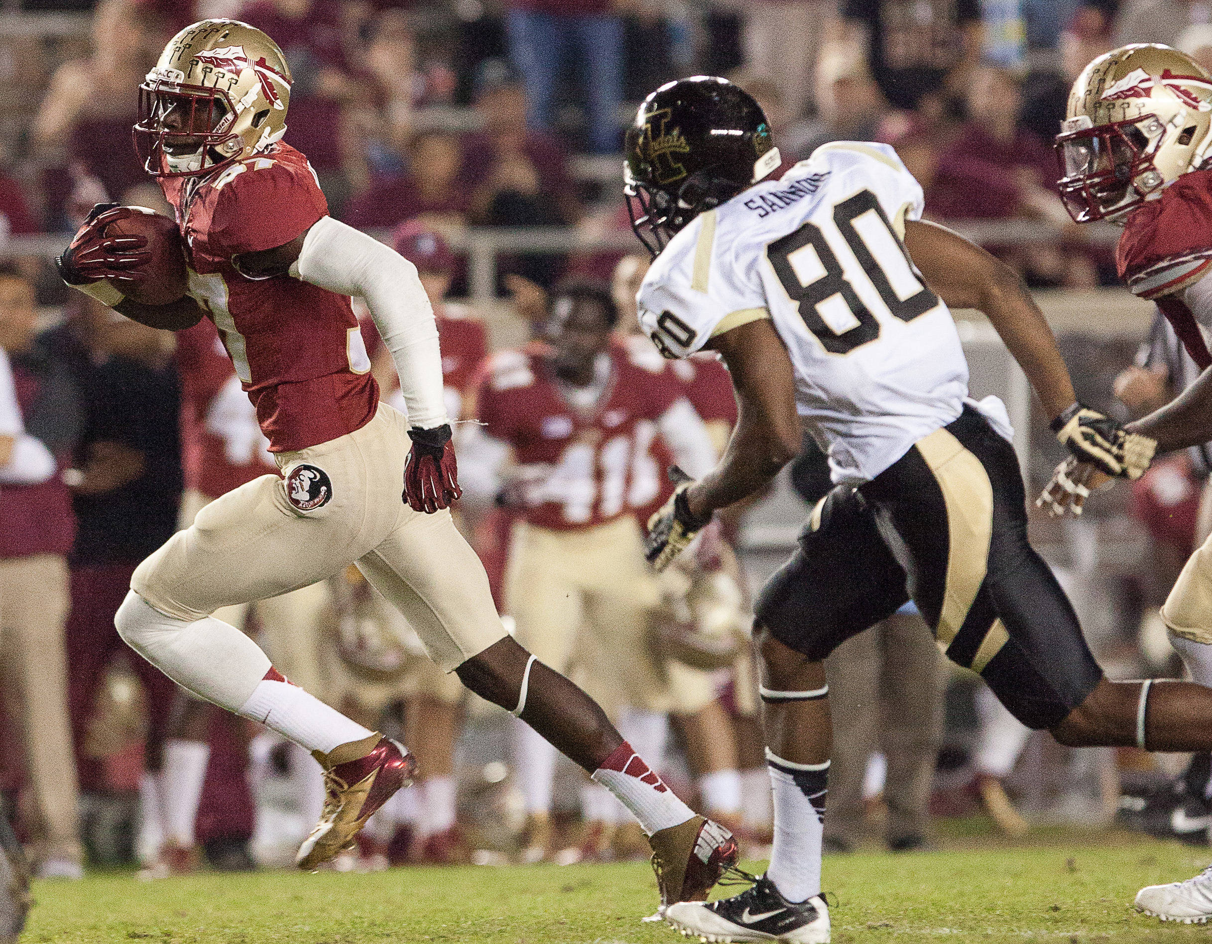 Keelin Smith (37) carries the ball after an interception during FSU Football's 80-14 victory over Idaho in Tallahassee, Fla on Saturday, November 23, 2013. Photos by Mike Schwarz.